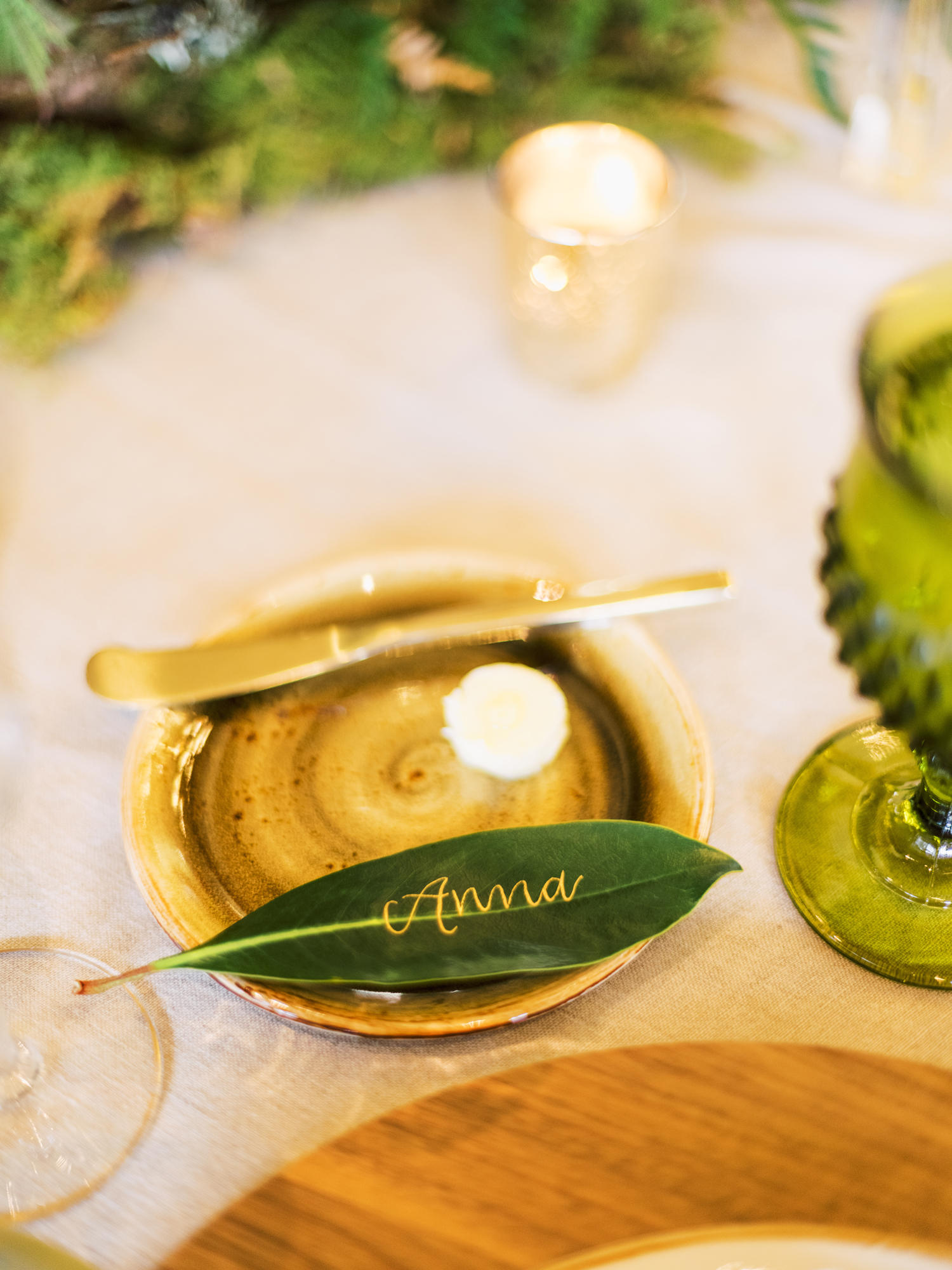 gold calligraphied leaves place cards
