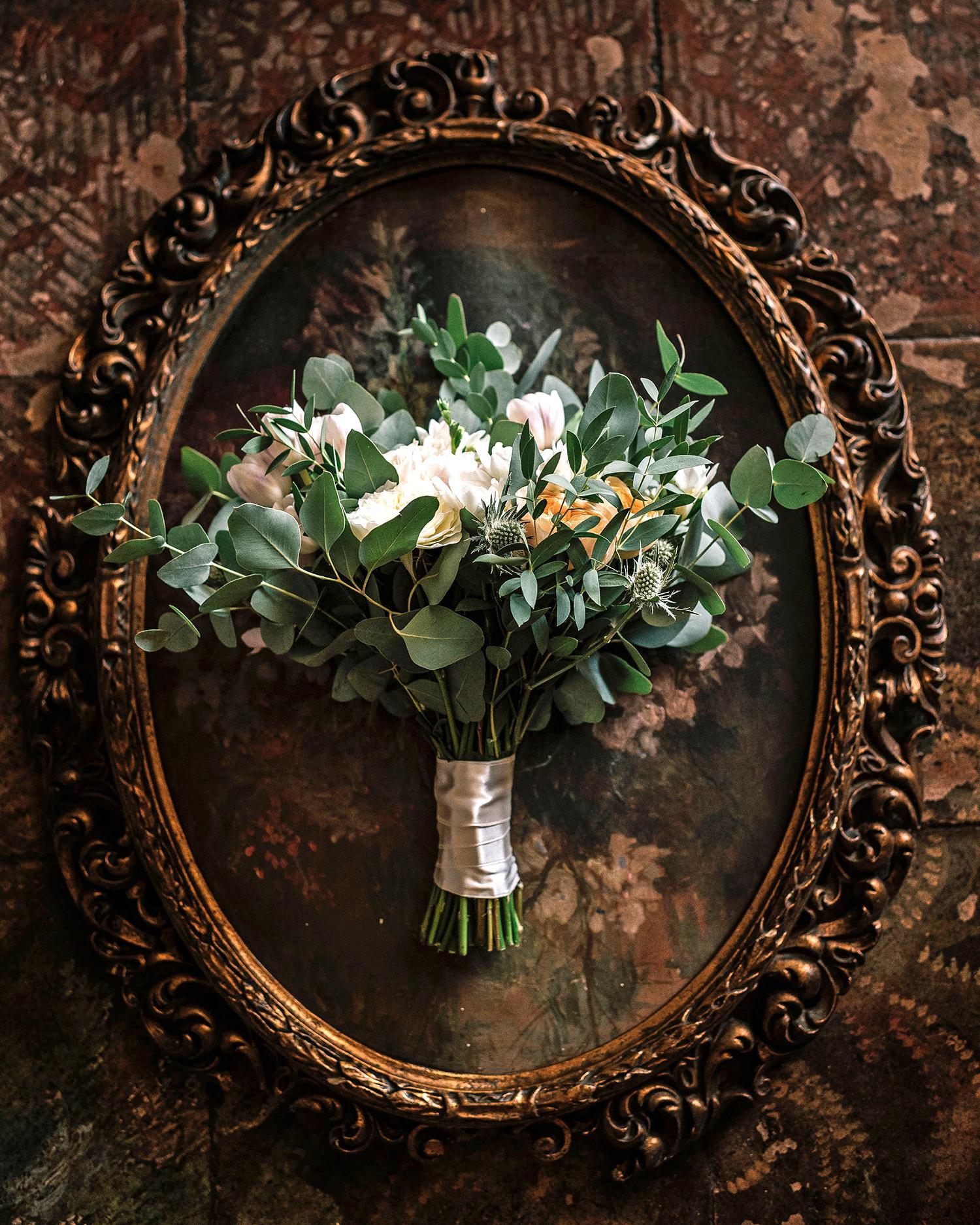 cara david wedding bouquet sitting on antique mirror