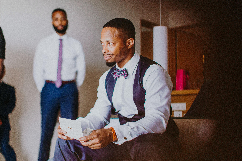 groom smile holding letter