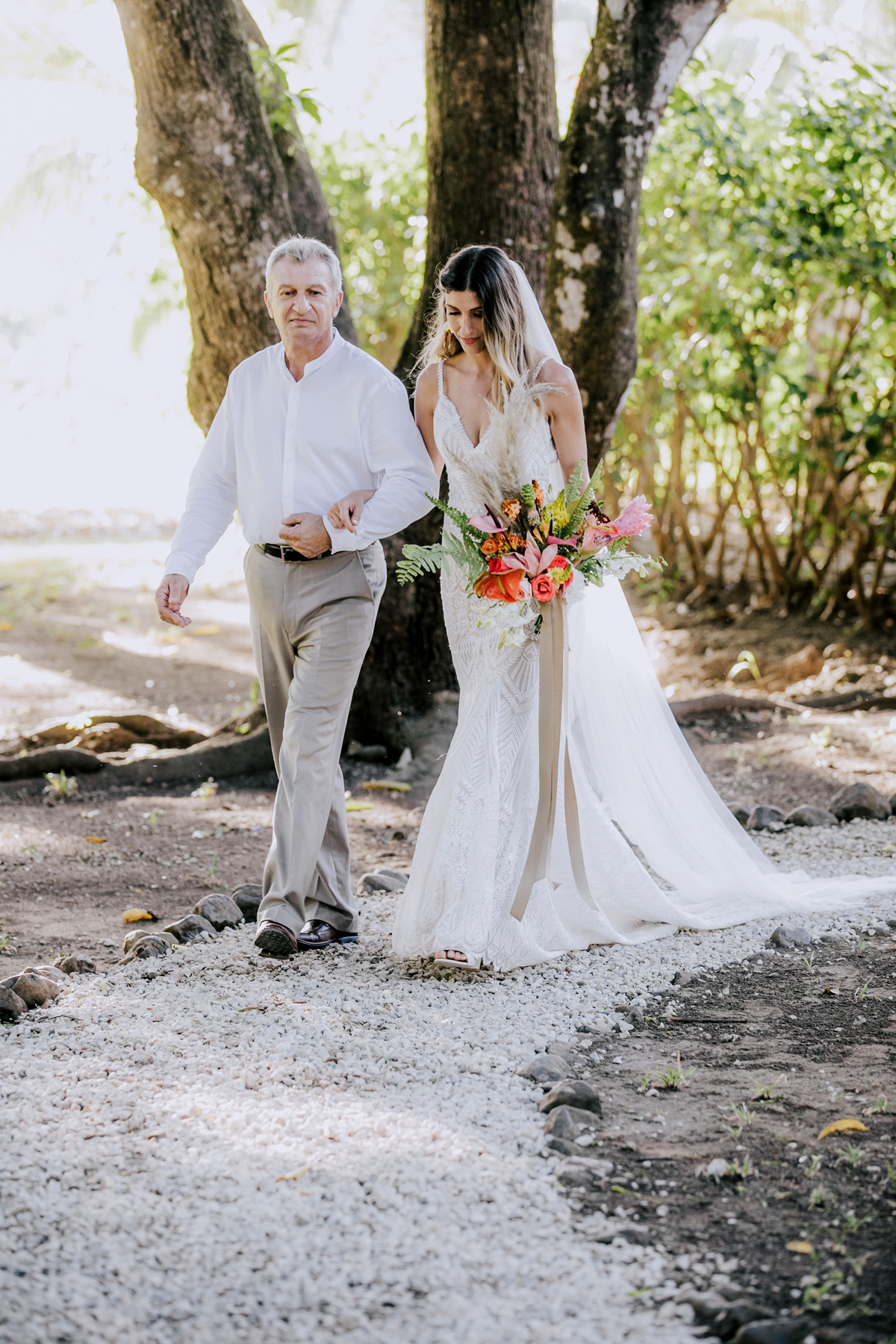 father of the bride walking bride down outdoor costa rican wedding venue aisle