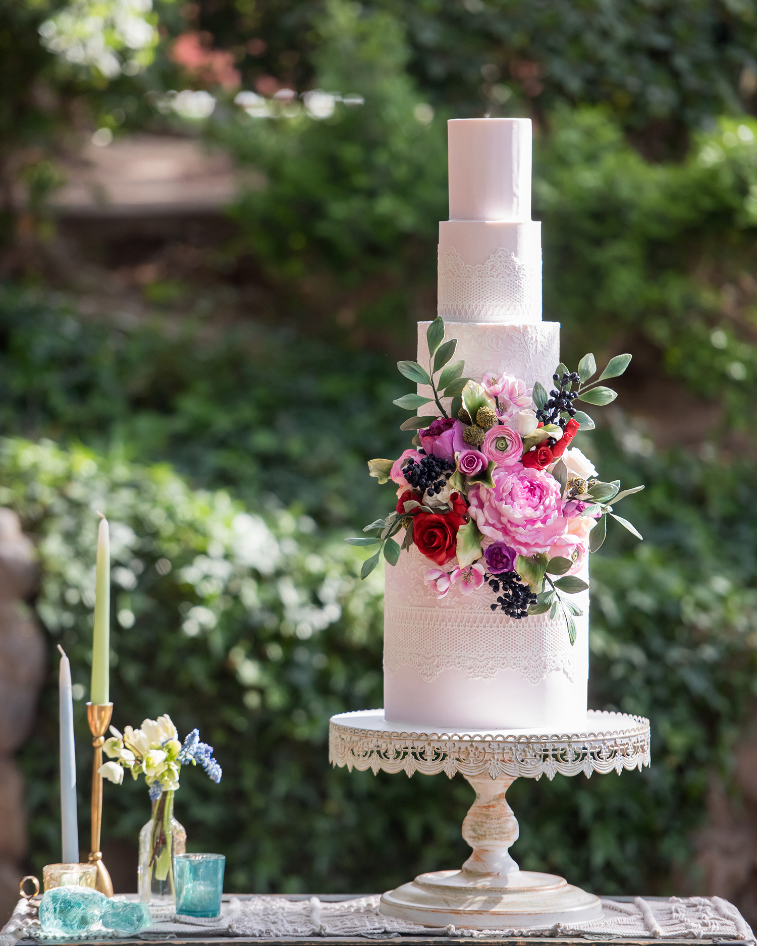 lace and bright florals wedding cake accents
