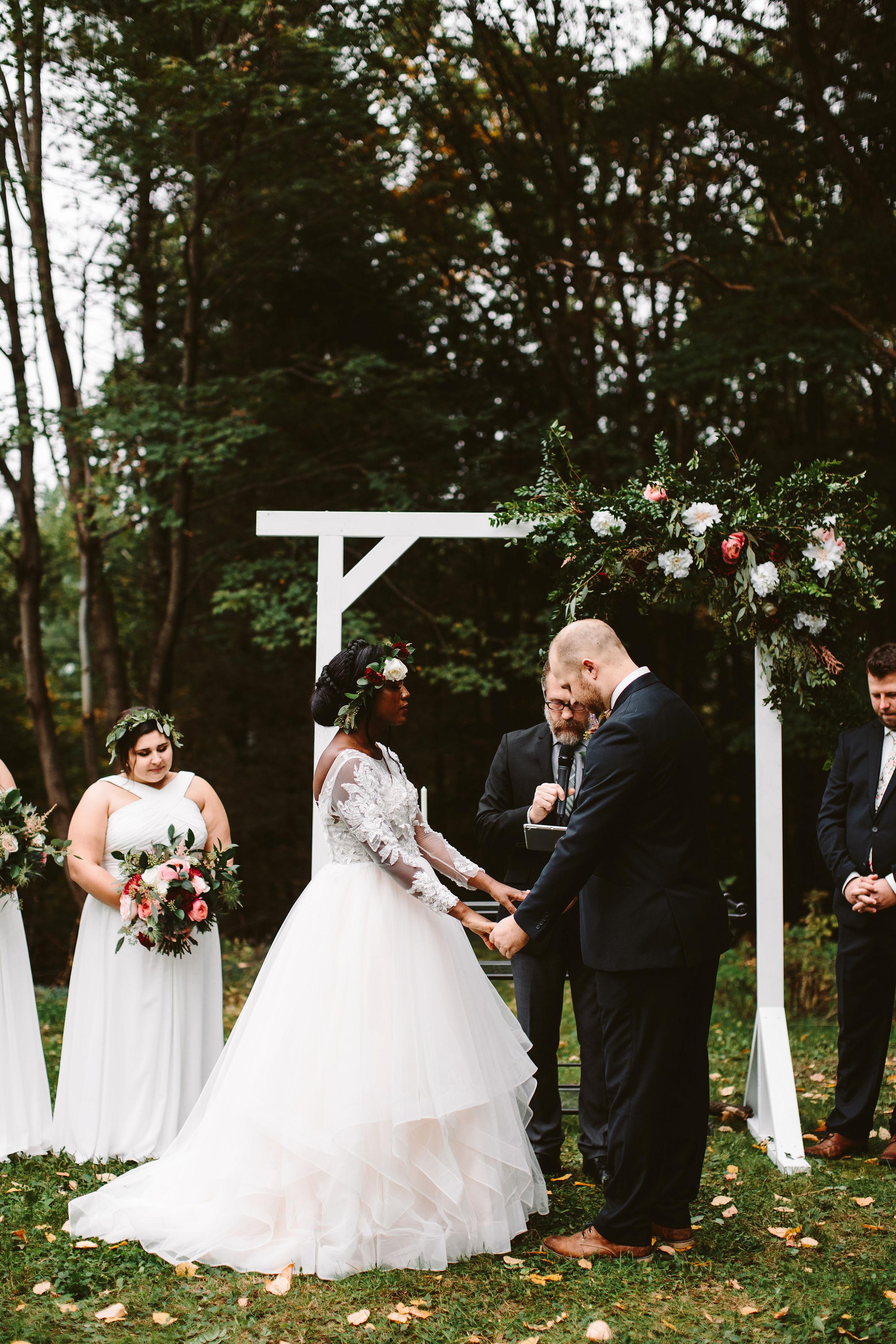 rivka aaron wedding ceremony couple holding hands