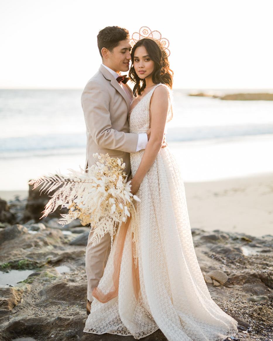 sunset wedding photos bride and groom embracing at laguna beach