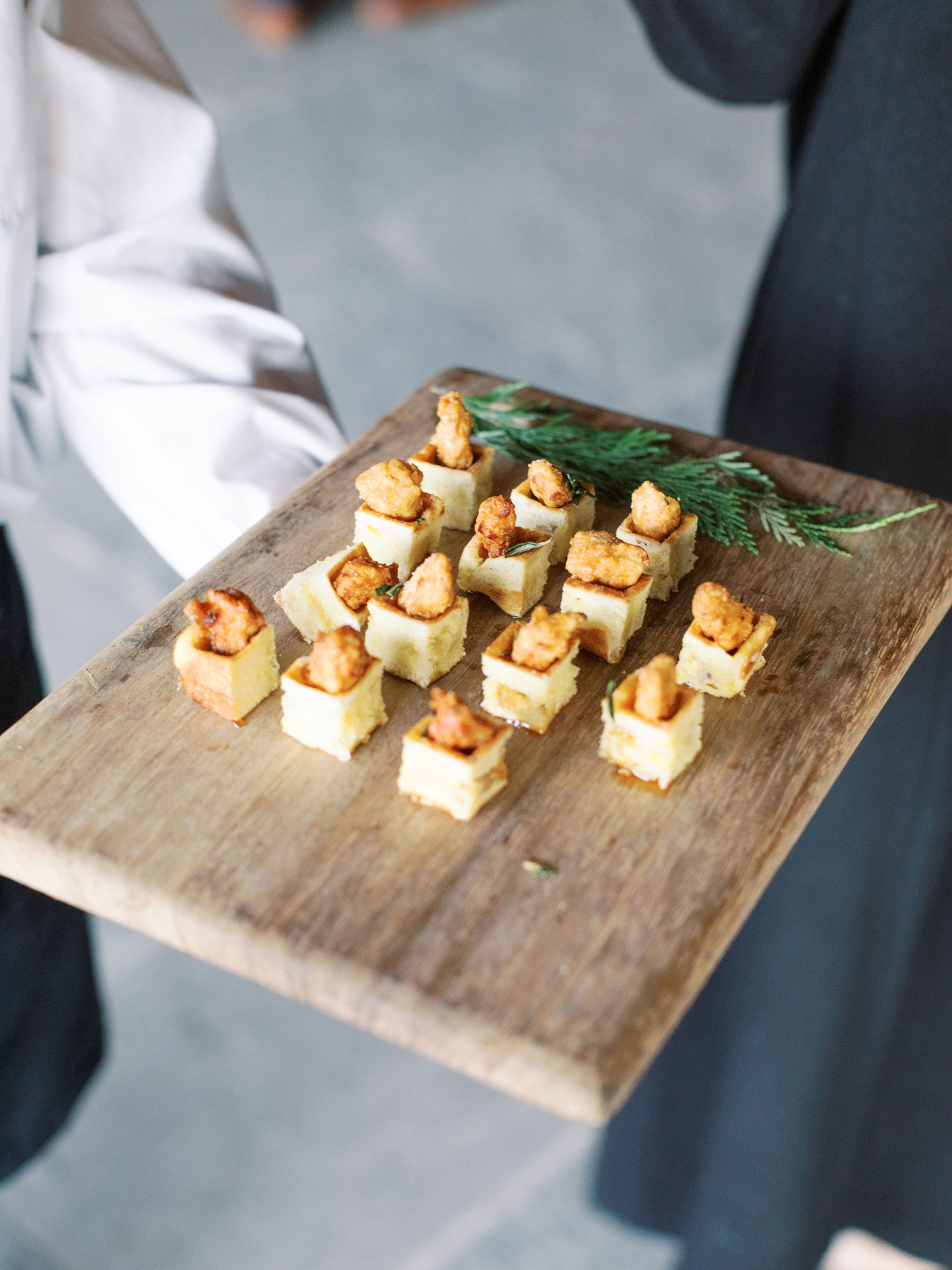 Crispy maple chicken on tiny buttered waffles hors d'oeuvres