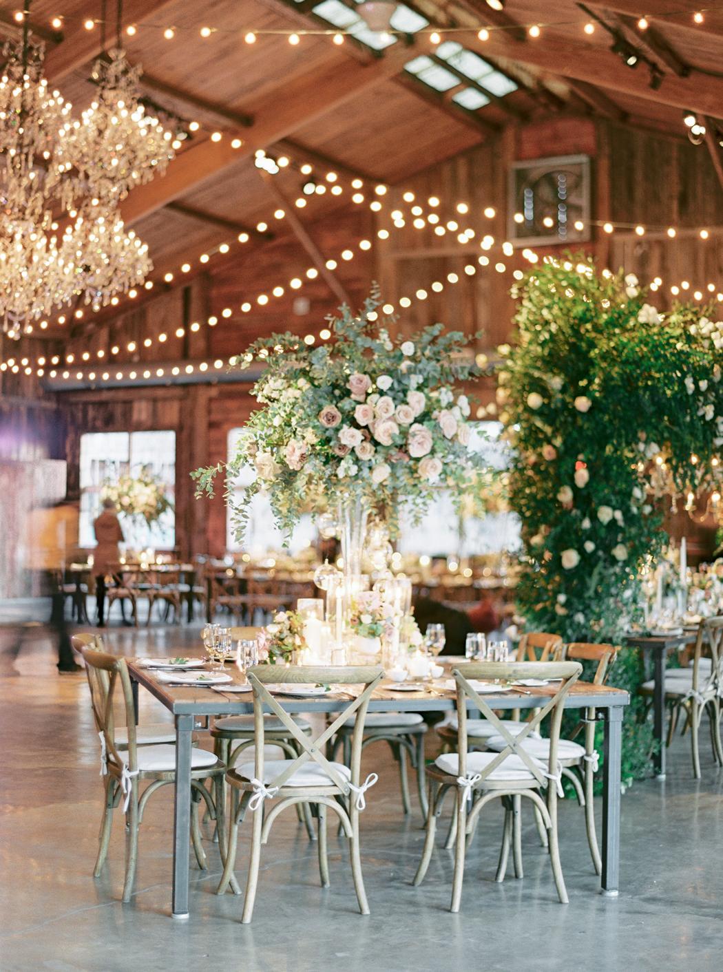 barn reception space hanging string lights