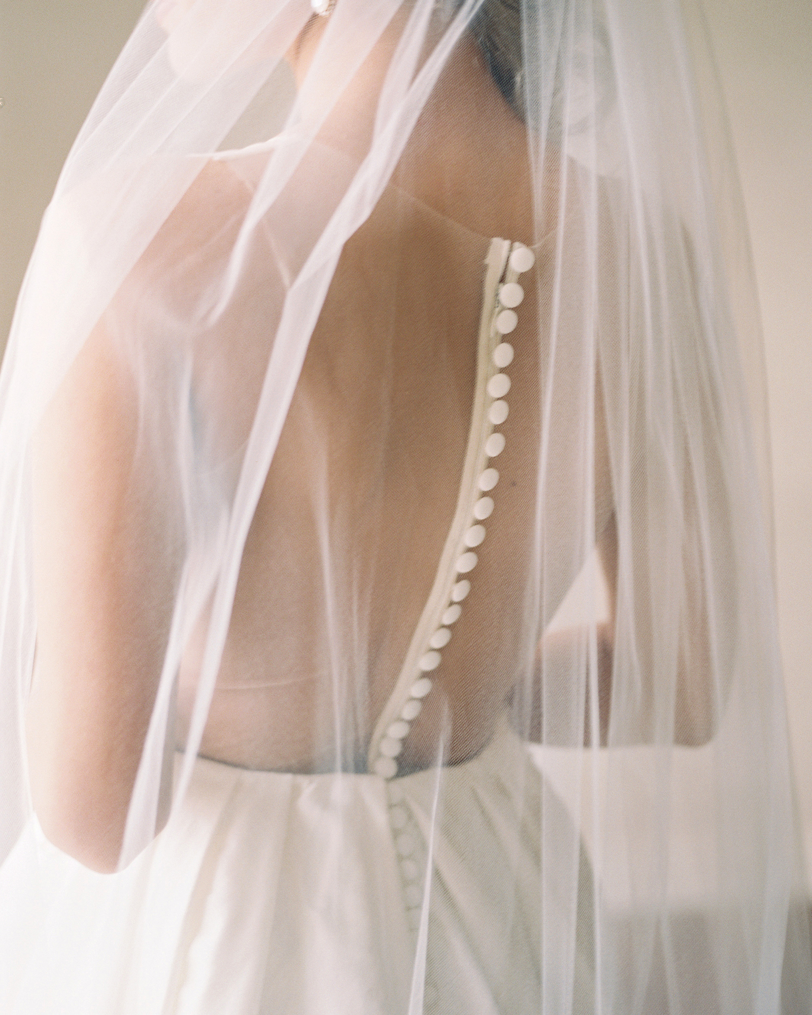 wedding dresses with buttons sheer veil