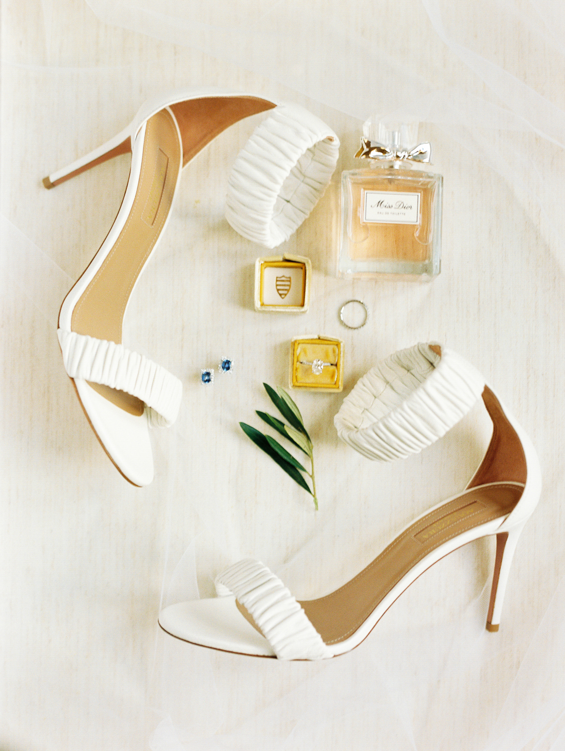 Miss Dior perfume, topaz earring studs, white pumps