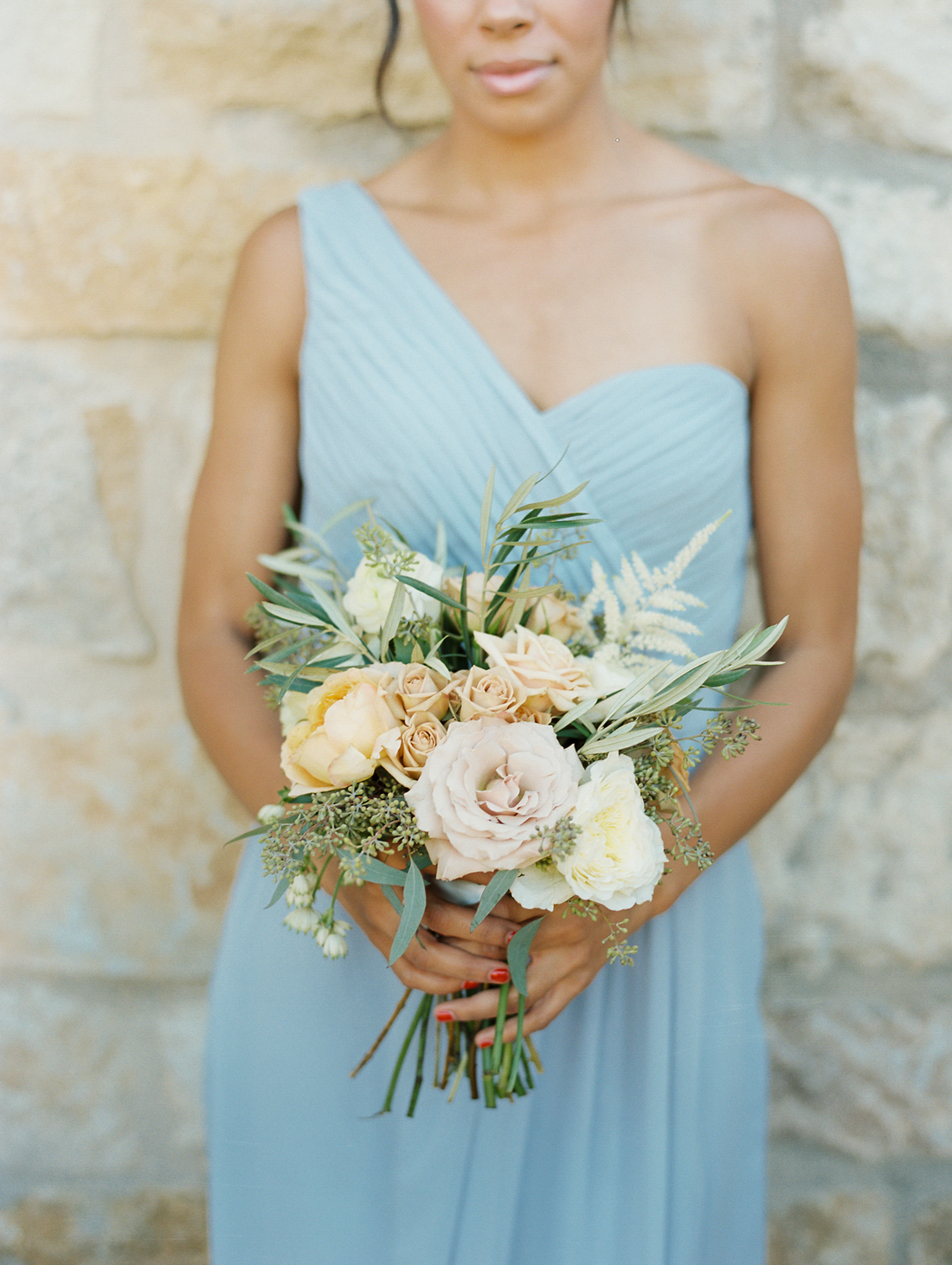 pastel colored roses, olive leaves, and seeded eucalyptus bridal bouquets
