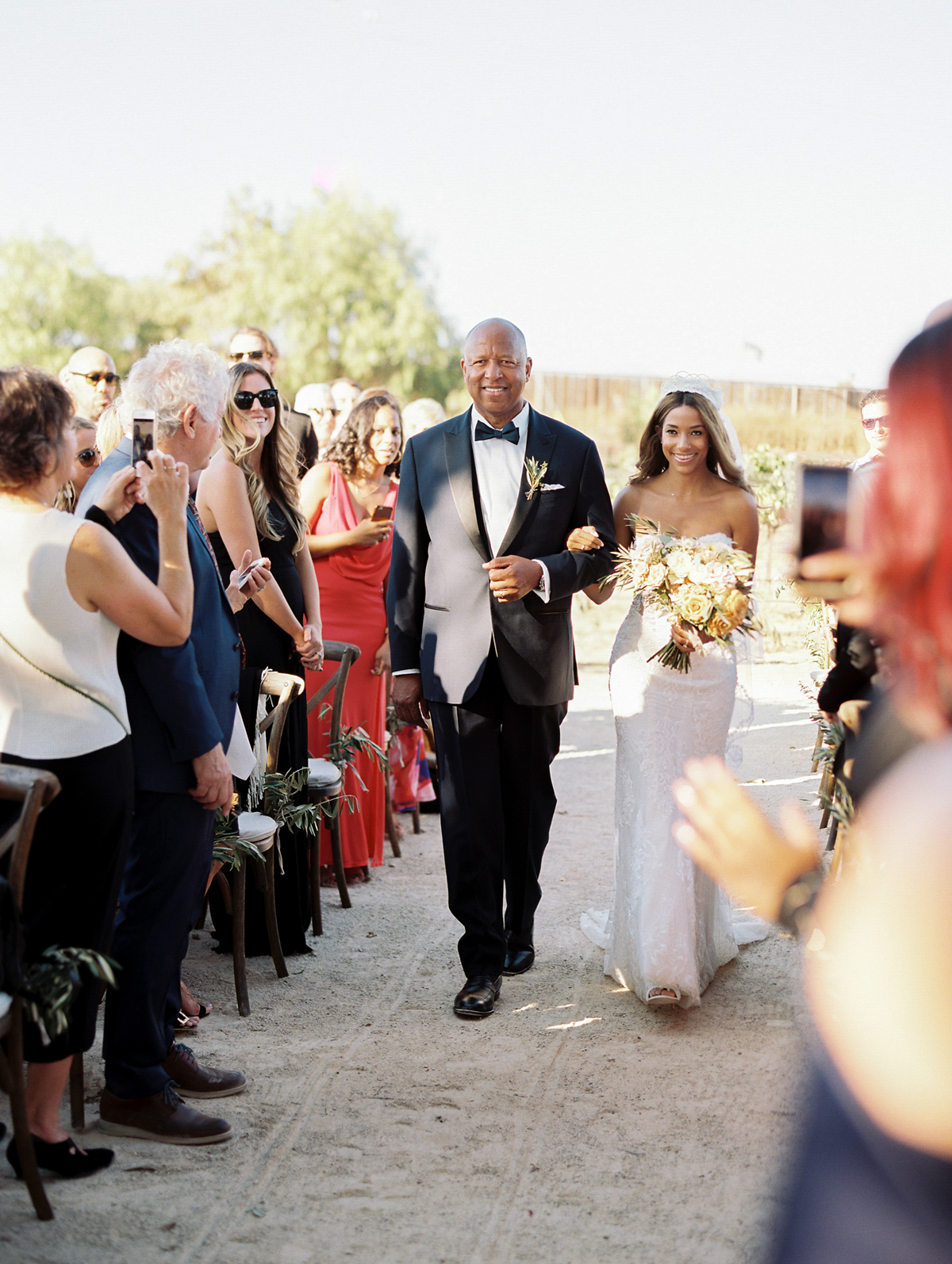 father of the bride walking bride down outdoor vineyard wedding aisle