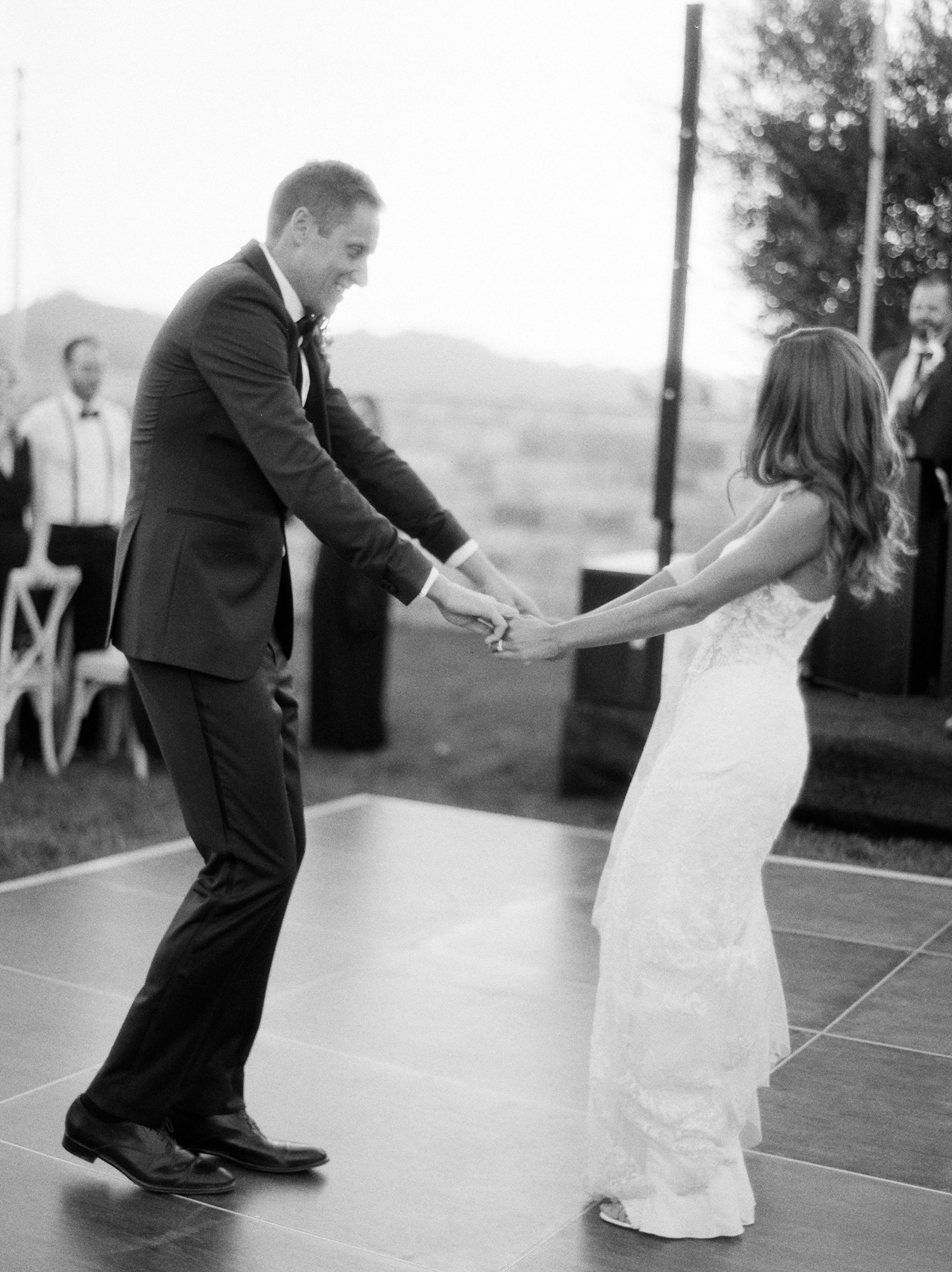 bride and groom first dance outside wedding reception