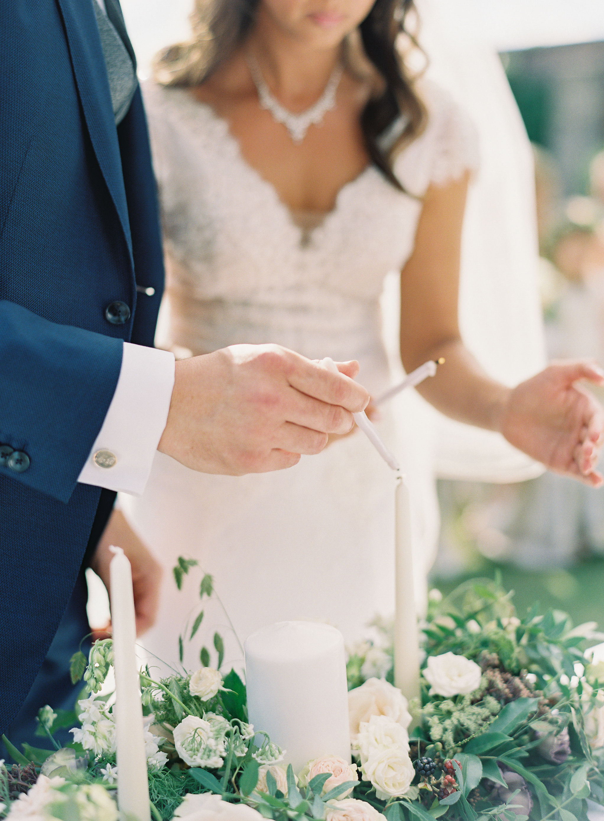 bride and groom lighting unity candle