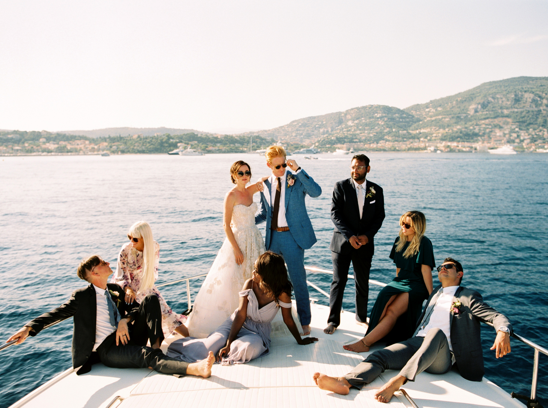 bride and groom with six person wedding party on boat