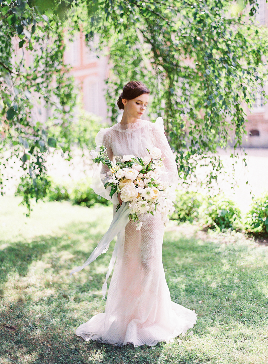 bride wearing high neck wedding dress