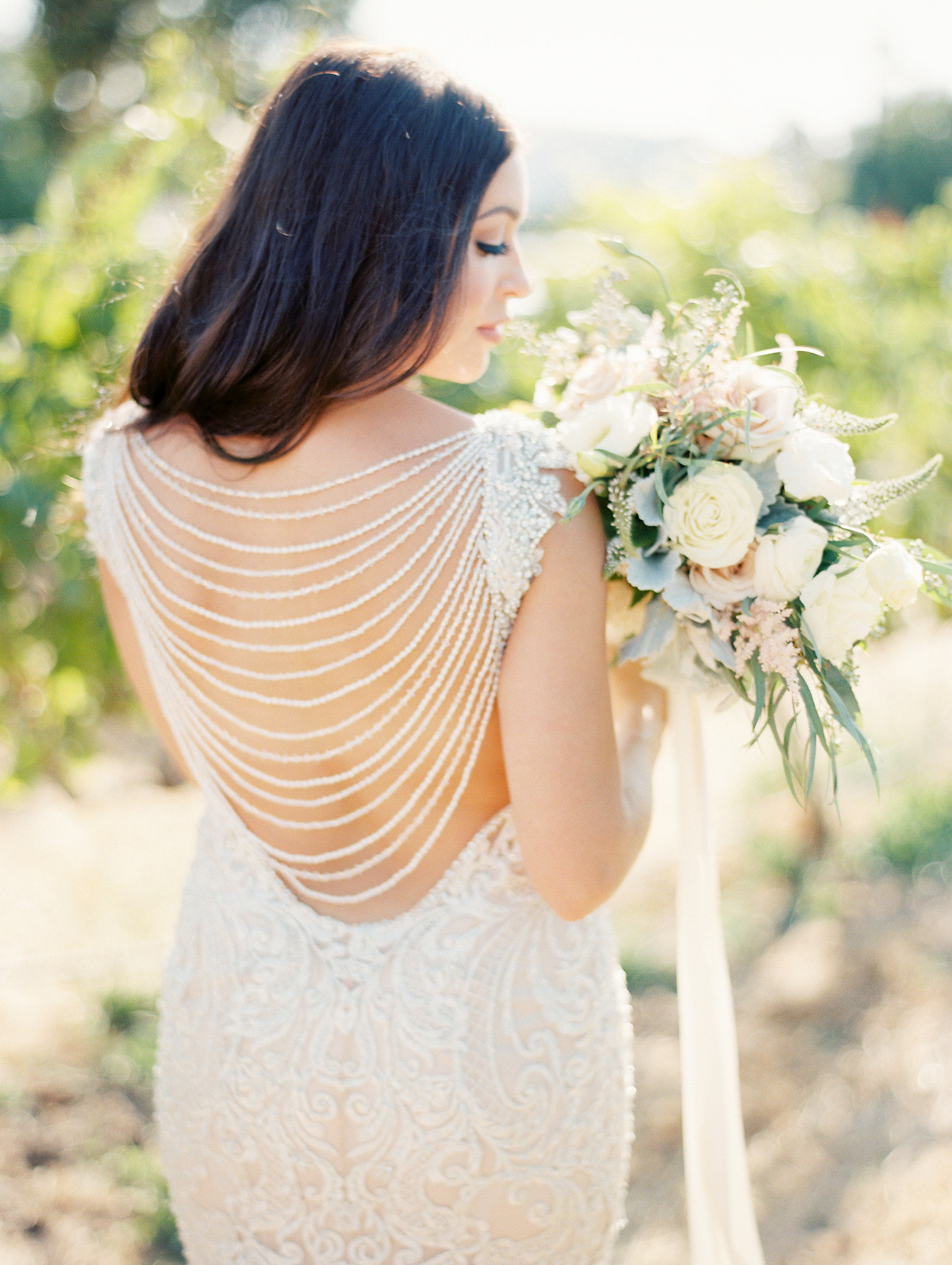 bride wearing open back design wedding dress