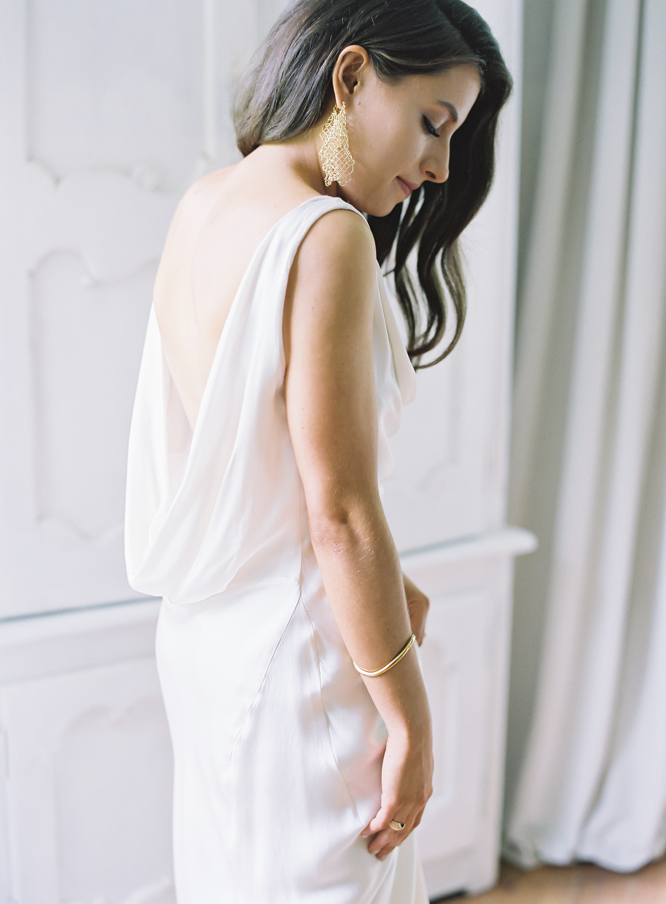 bride wearing cowl back wedding dress