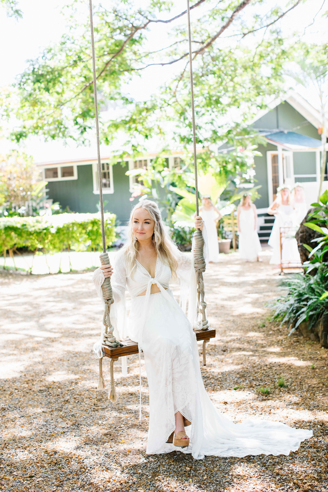 bride wearing tied front long sleeve train dress