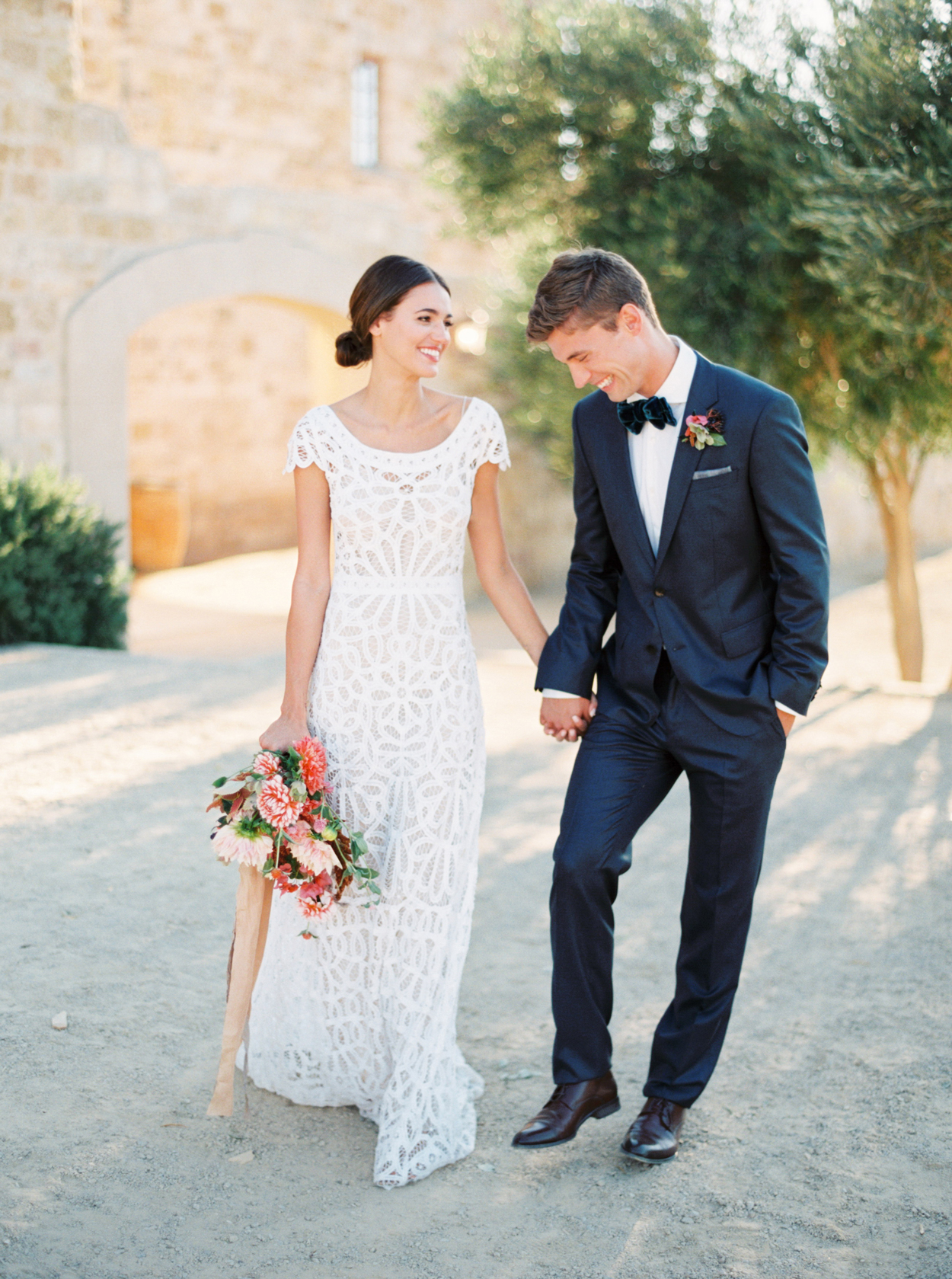 bride wearing lace cap sleeve wedding dress