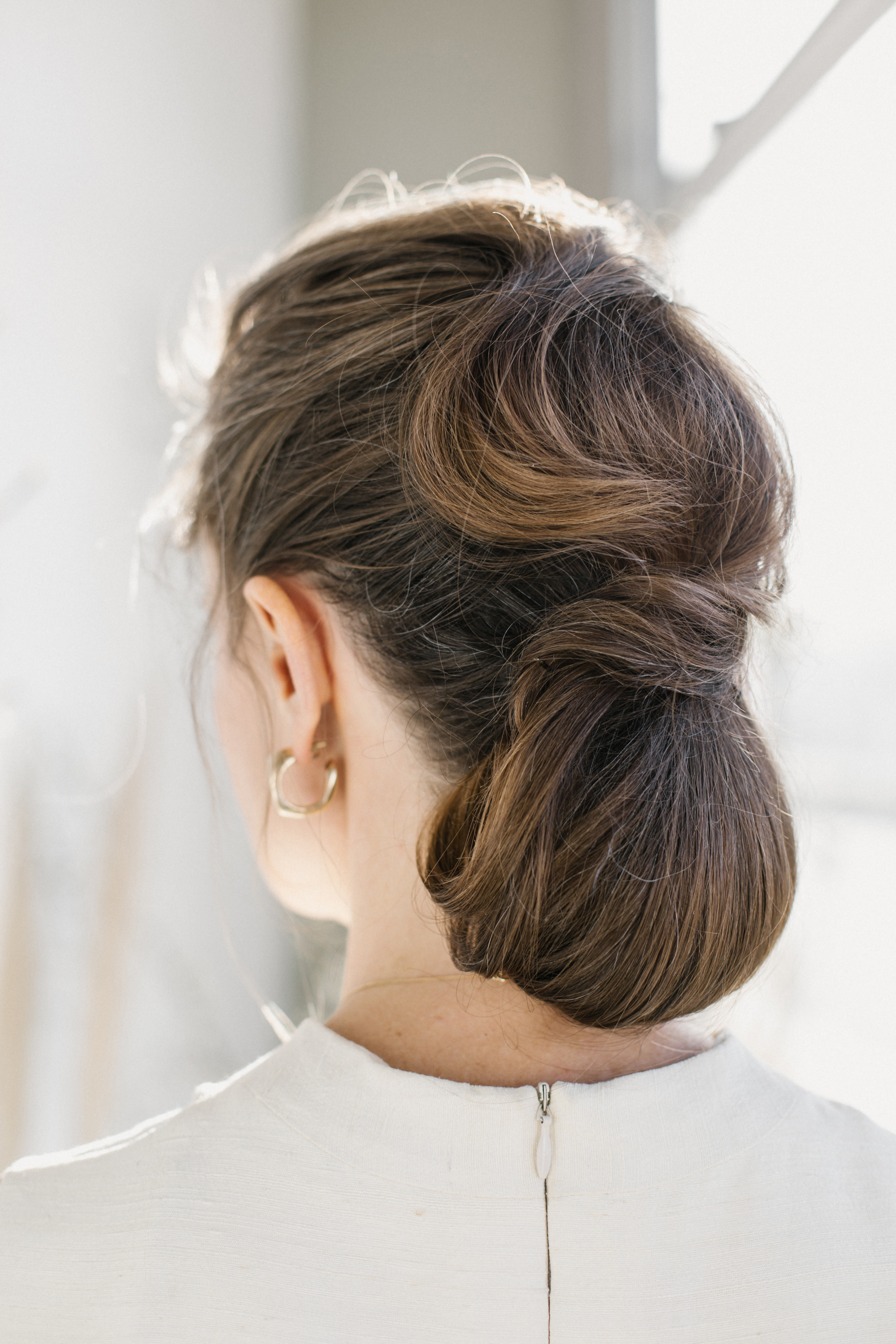 bride low bun hairstyle elongated waves