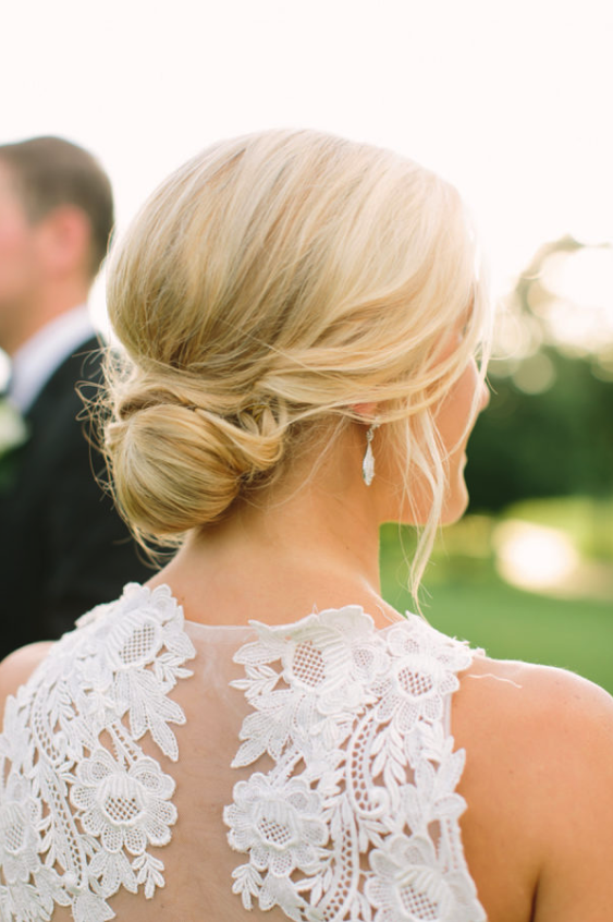 bride low bun hairstyle swept back casual