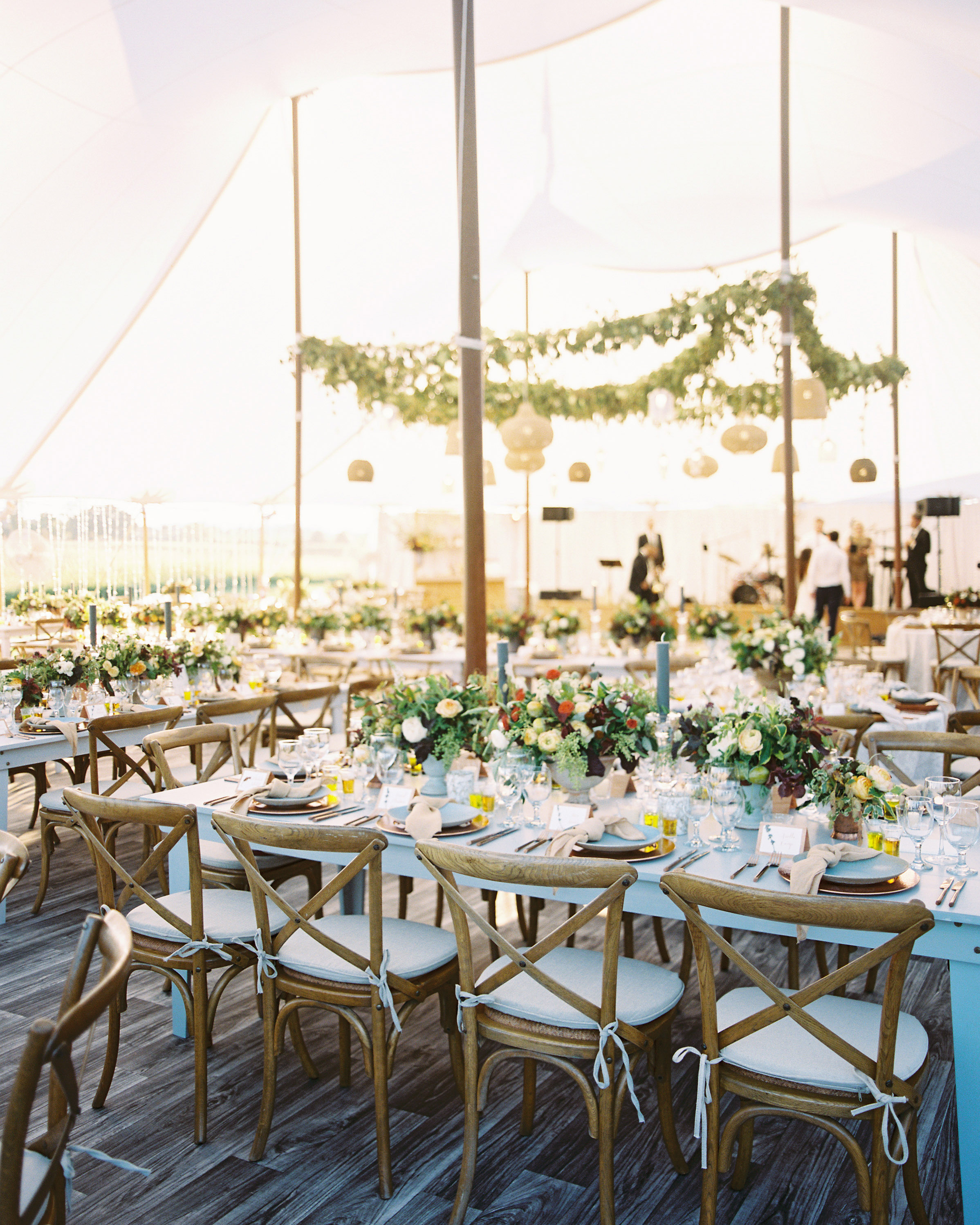 wedding reception party tent long wooden tables