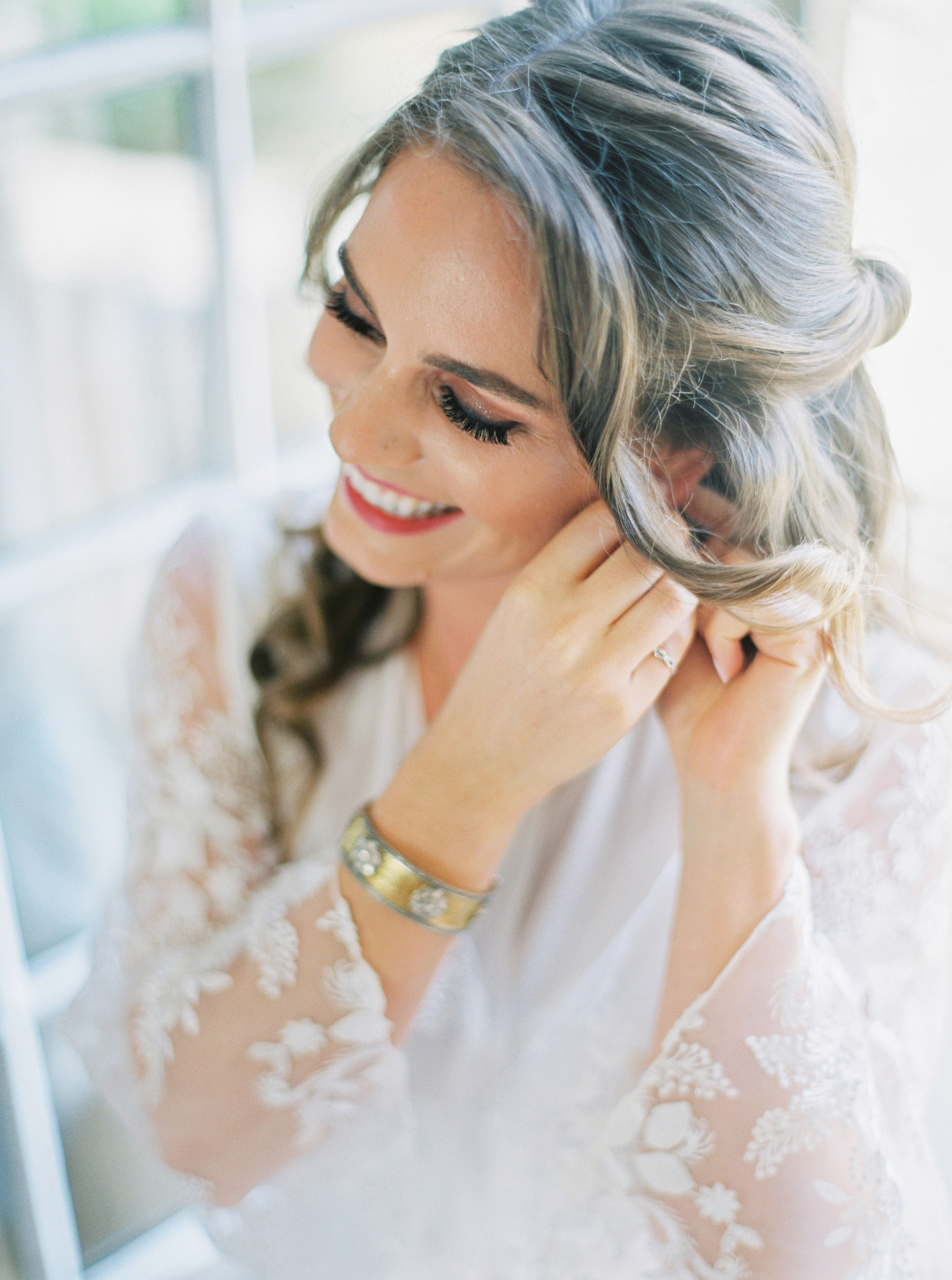 bride smiling while getting ready