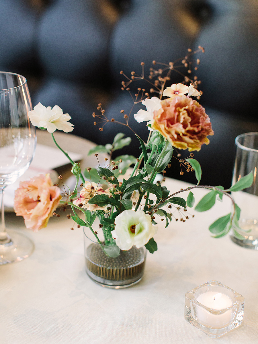 floral centerpiece in glass jar