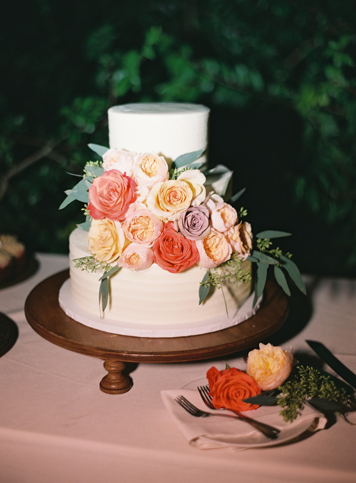 earl gray frosted wedding cake with floral accents