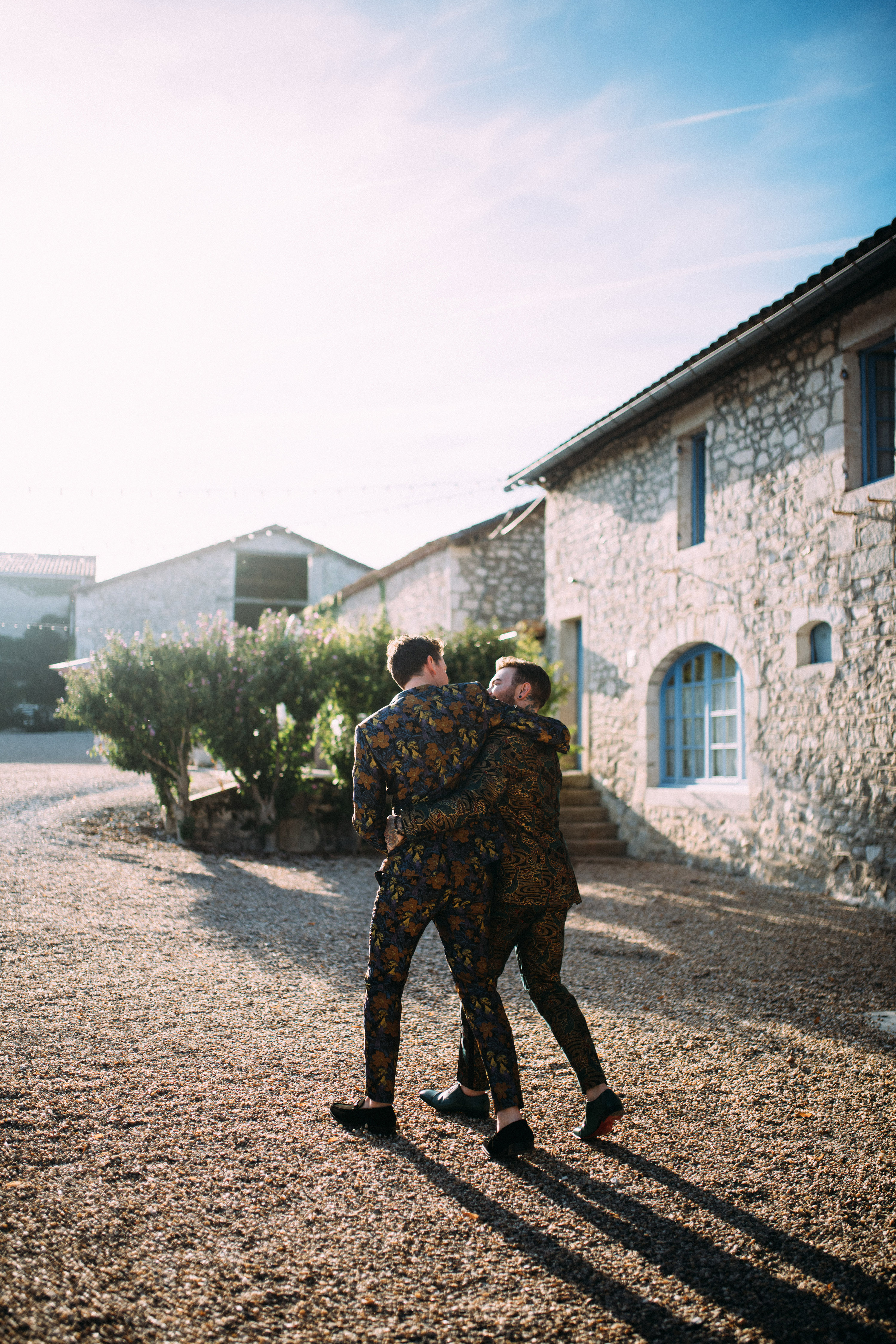 thomas jared wedding grooms couple walking at venue
