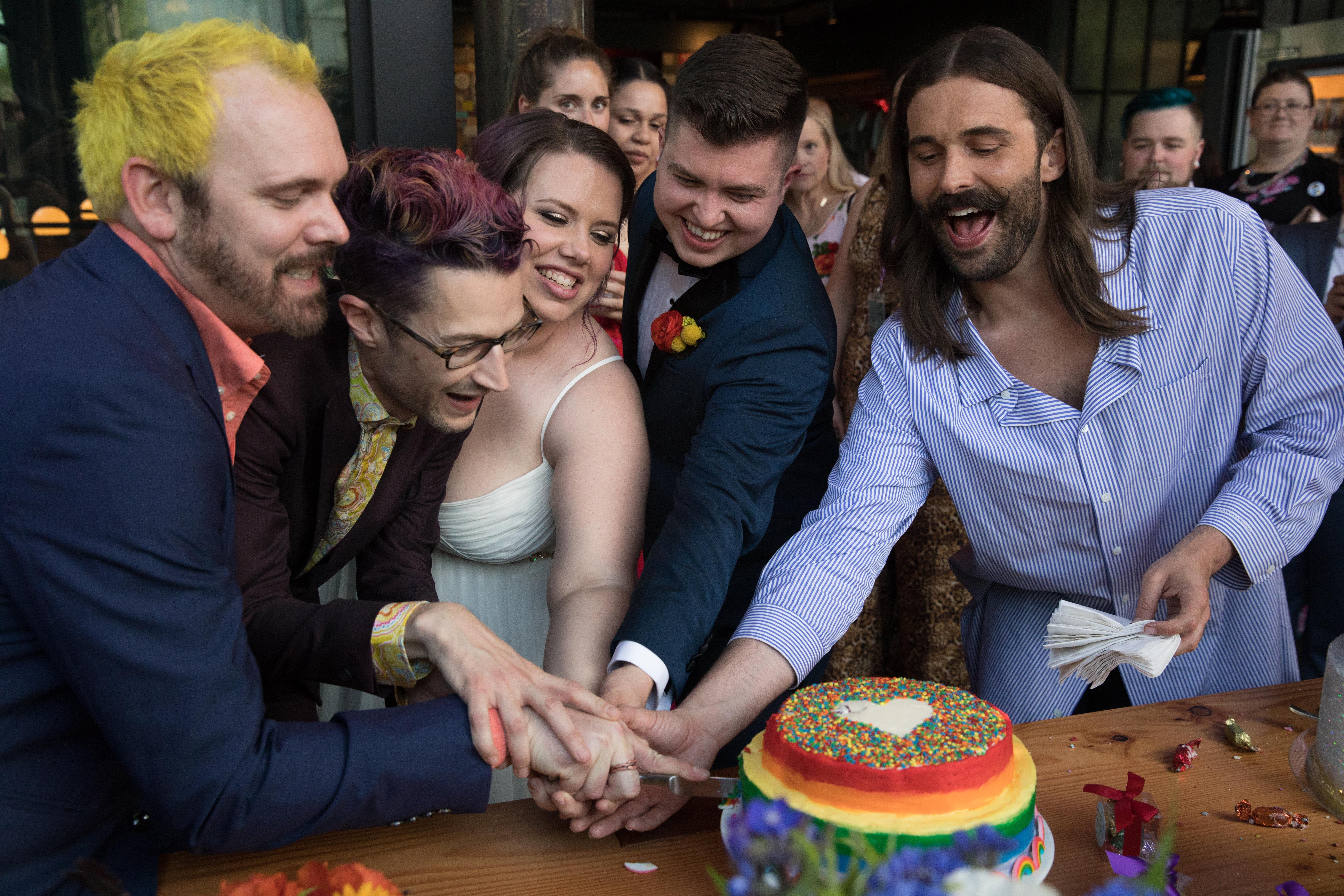jonathan van ness wedding officiant cutting cake