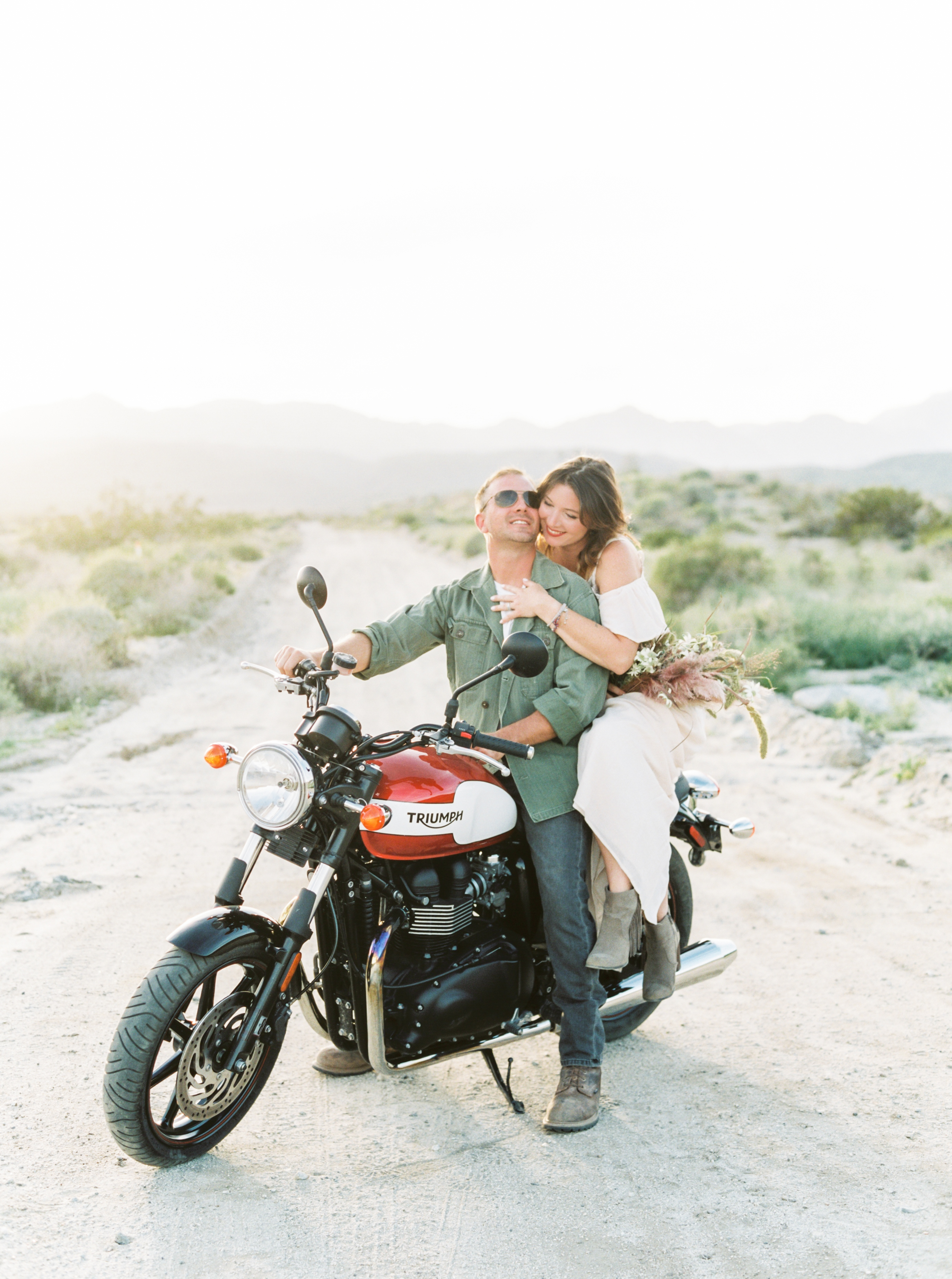 couple on motorcycle engagement photo