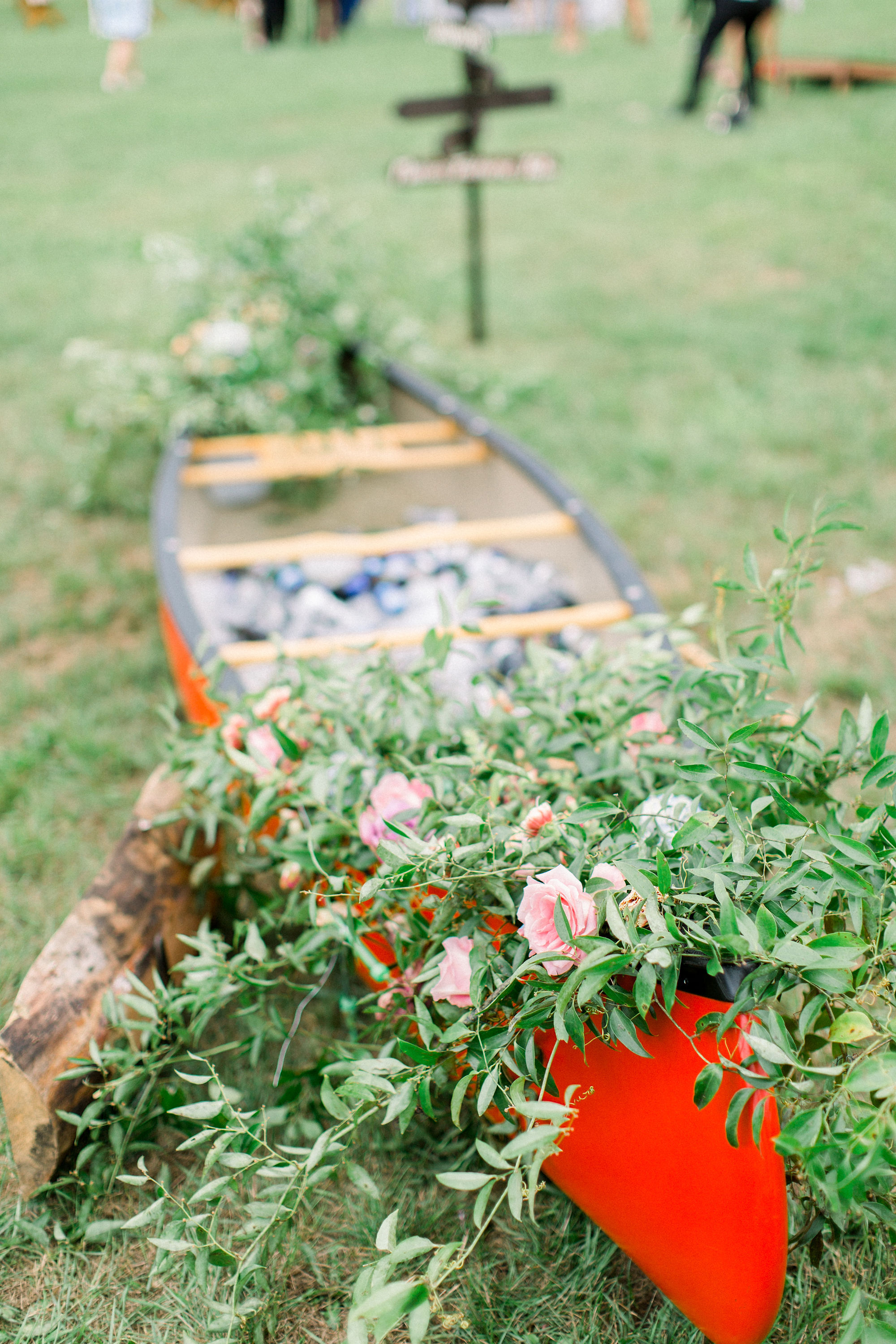 lauren josh wedding red canoe with flowers
