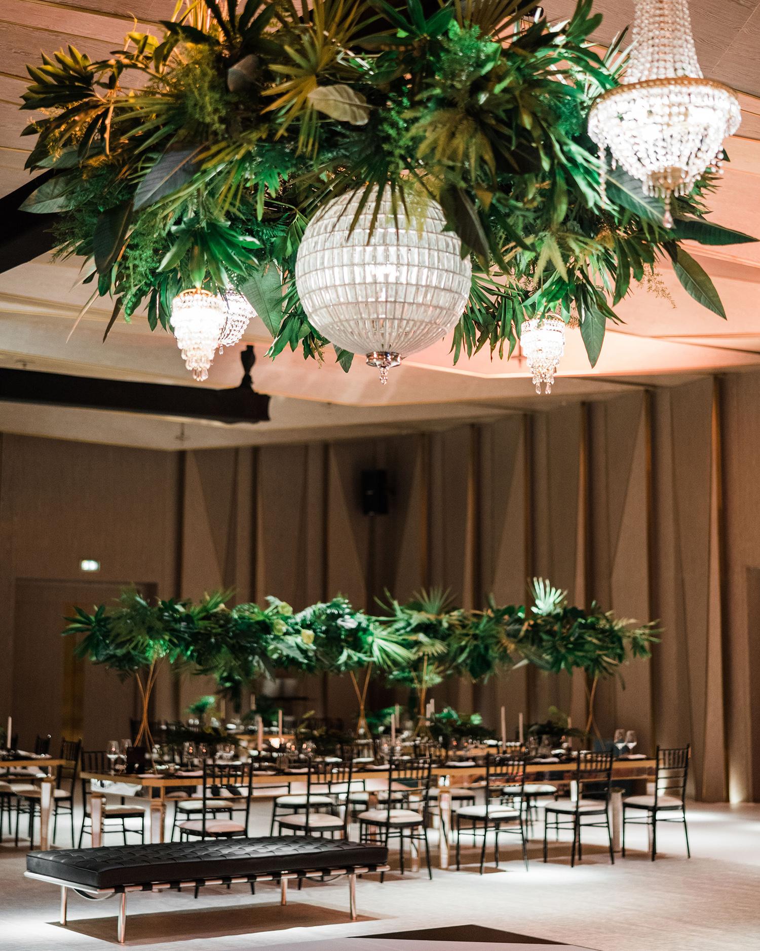 vanessa abidemi wedding indoor reception with hanging greenery