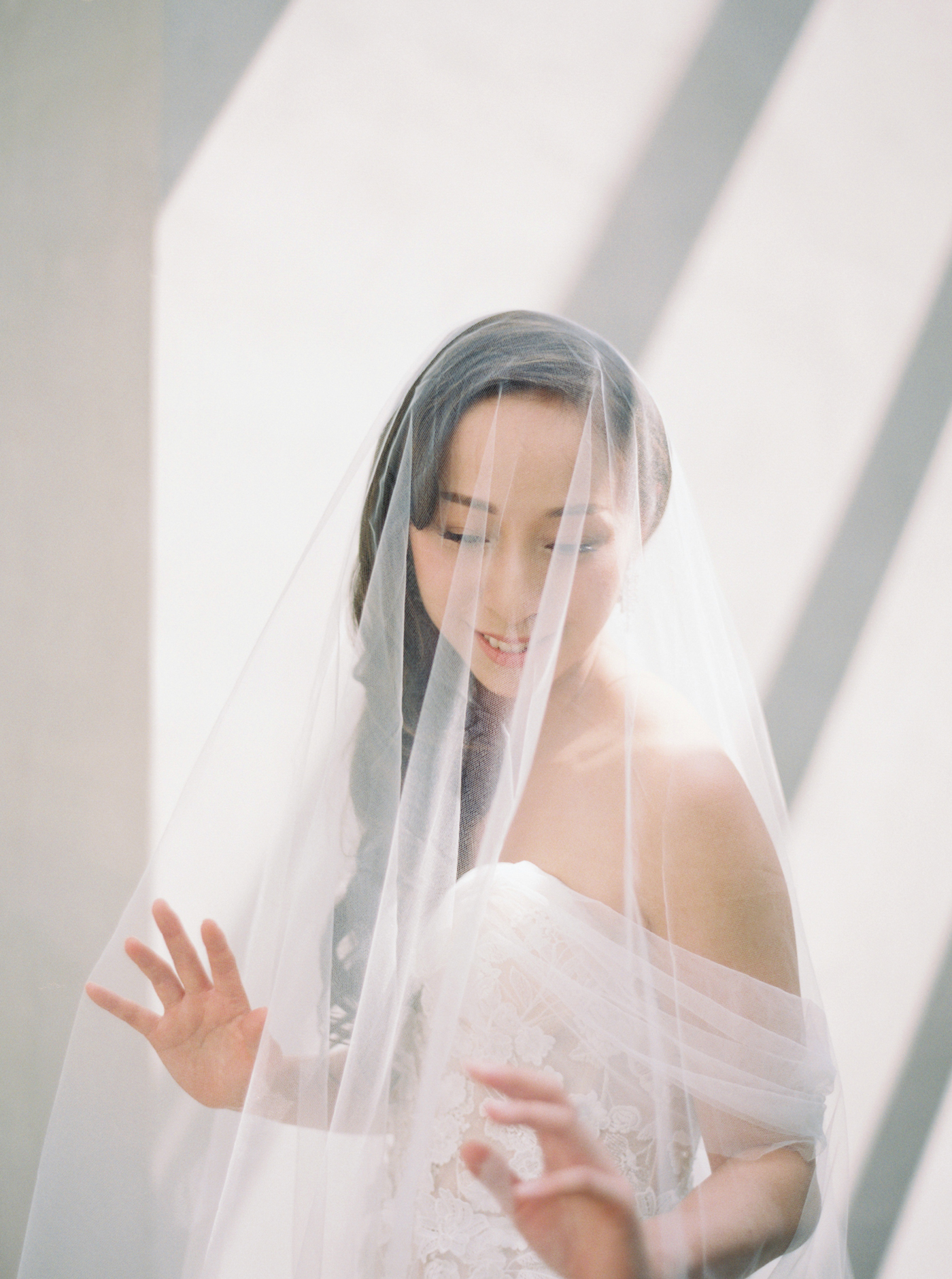 bride wearing a sara gabriel wedding veil