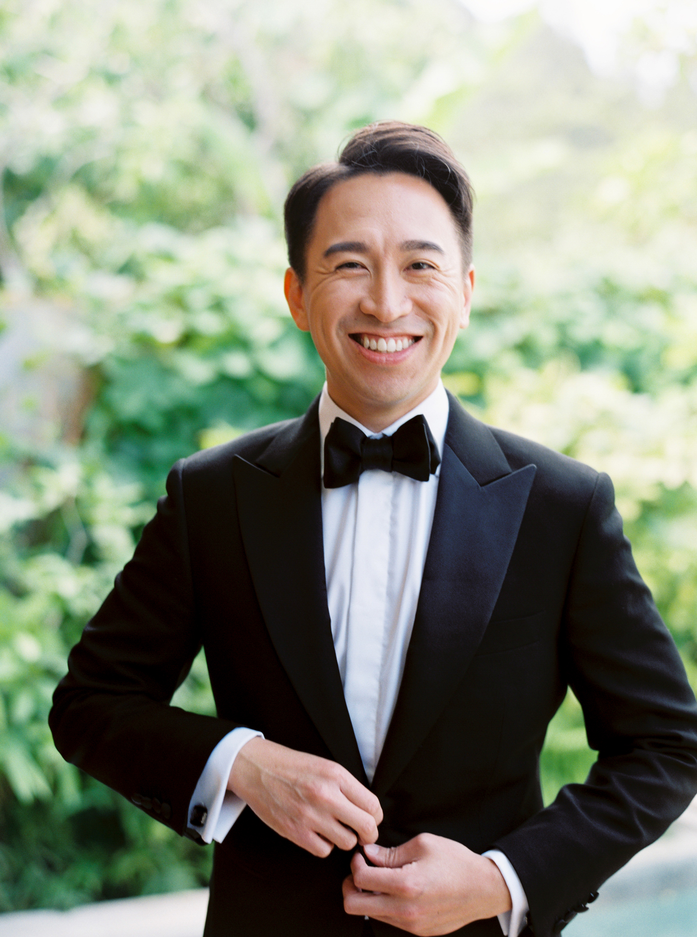 groom wearing classic black tuxedo
