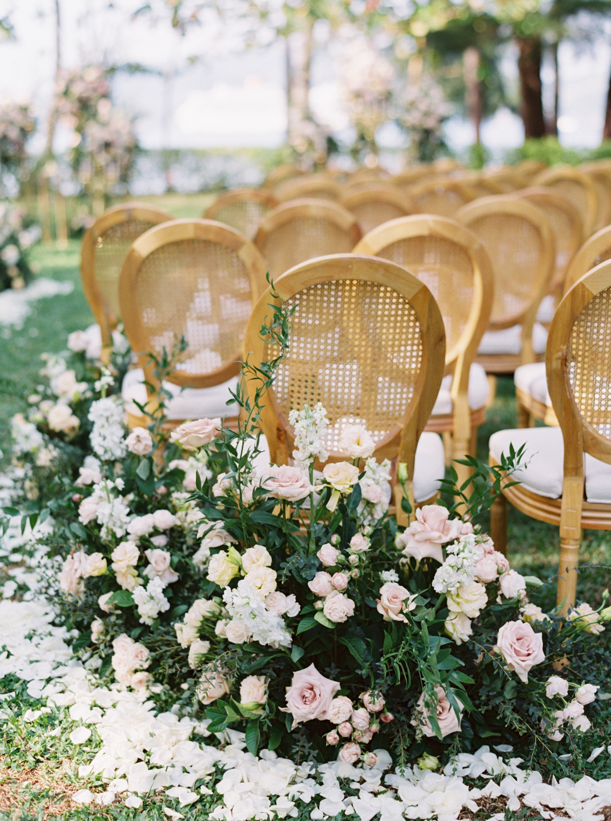 roses and greenery lining wedding aisle