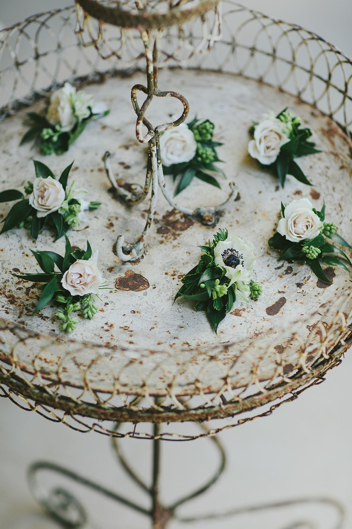 sarah daniel wedding boutonnieres on antique tray