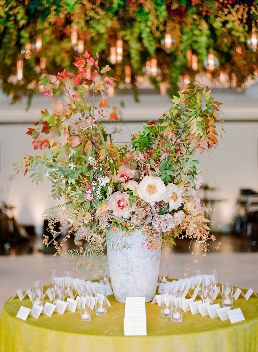 stone vase centerpiece on yellow tablecloth