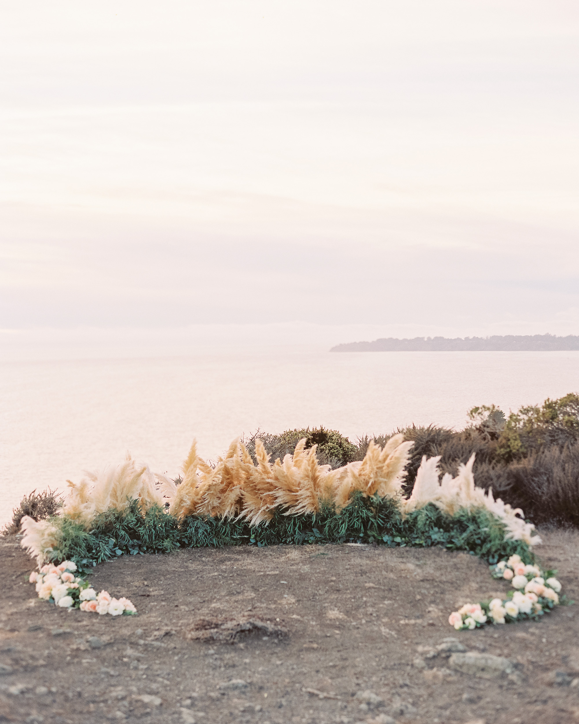 wedding ground floral arch pampas grass crescent
