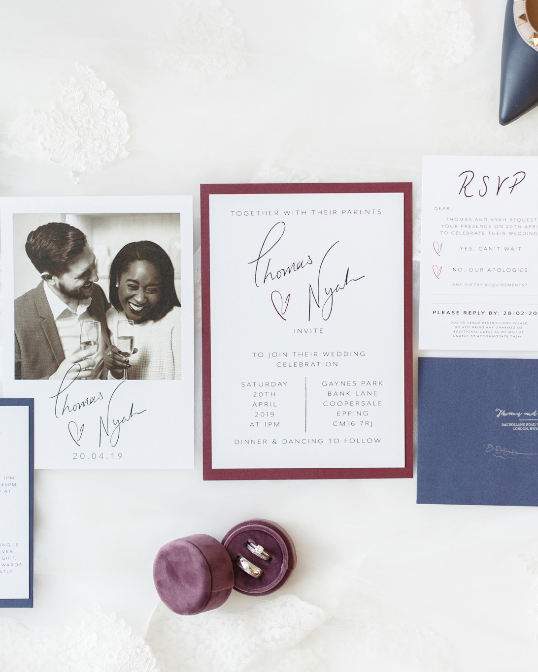 ryan thomas wedding invites in white, purple, and navy