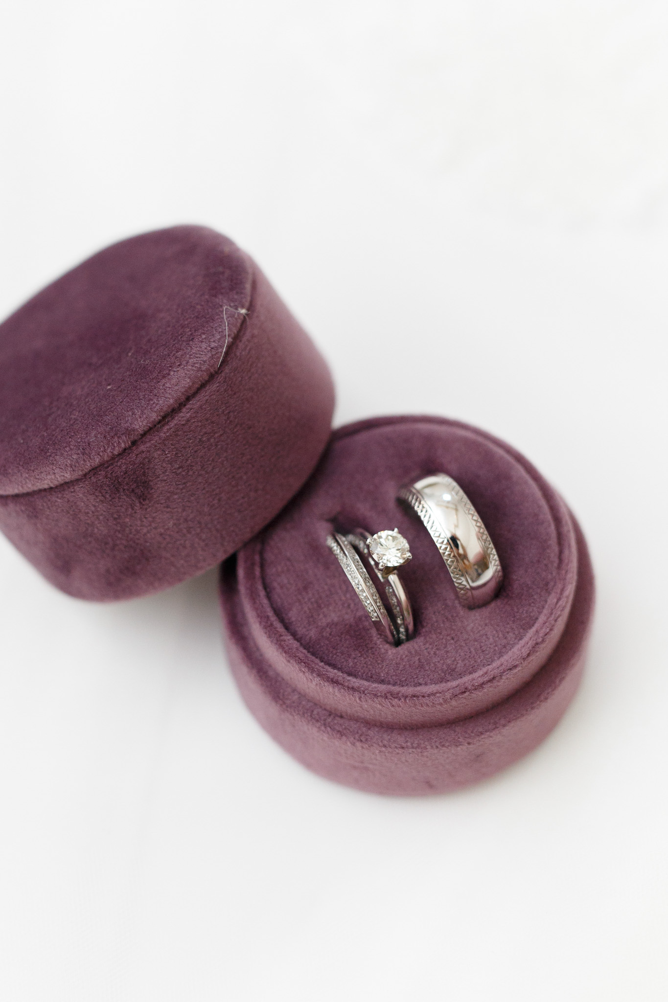 ryan thomas wedding rings in purple round box