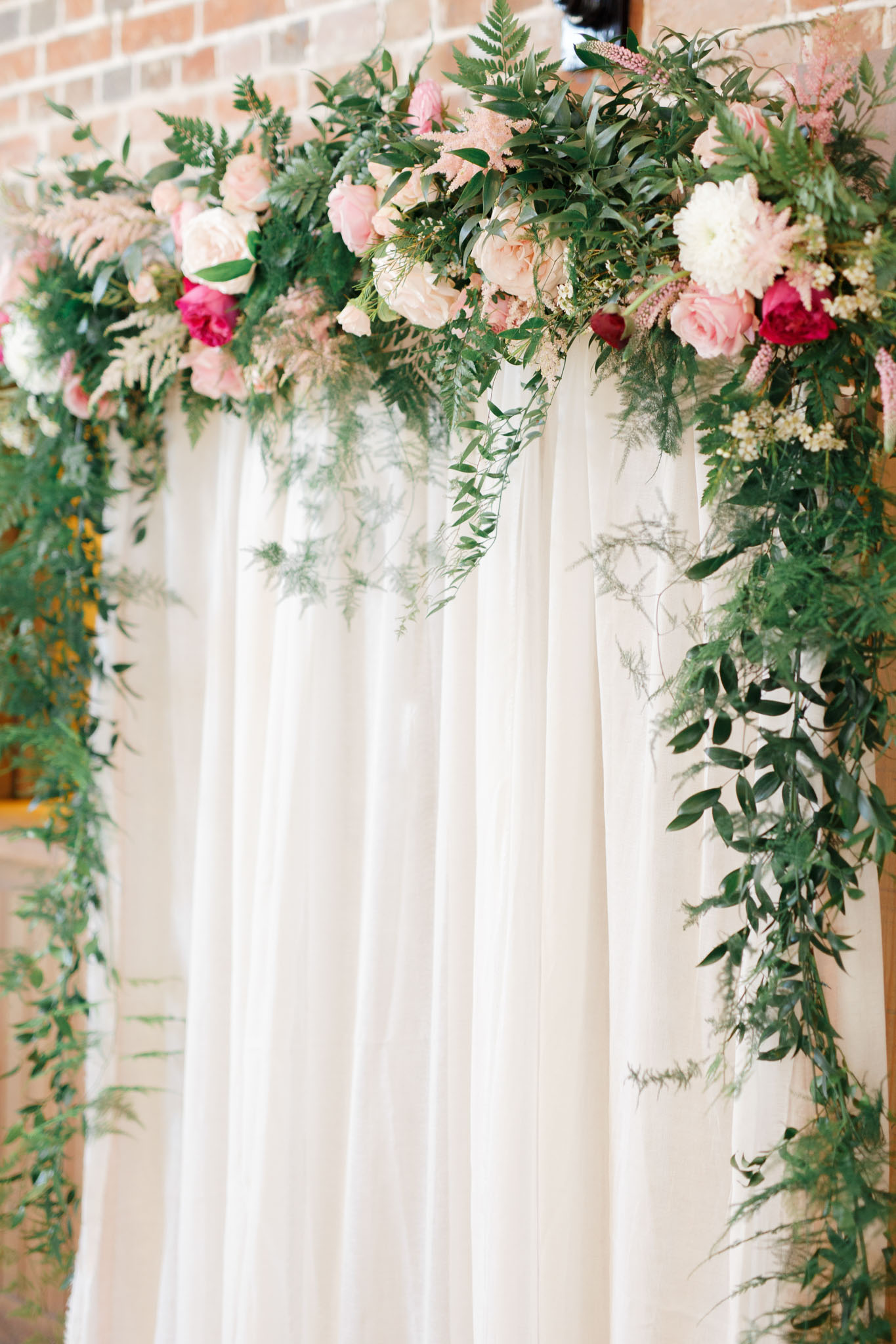 ryan thomas wedding arch with flowers
