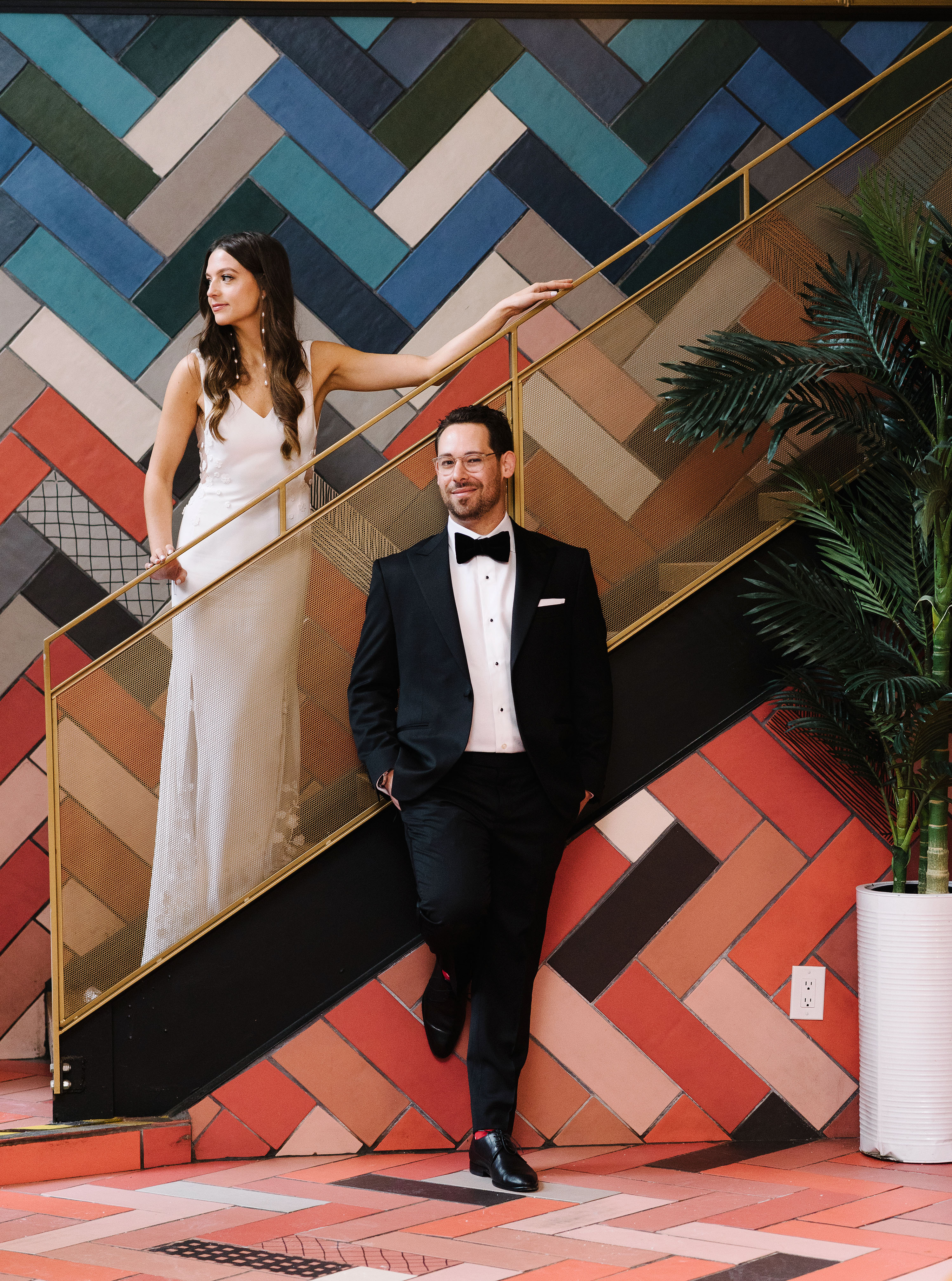 krista will wedding couple posing on art deco staircase