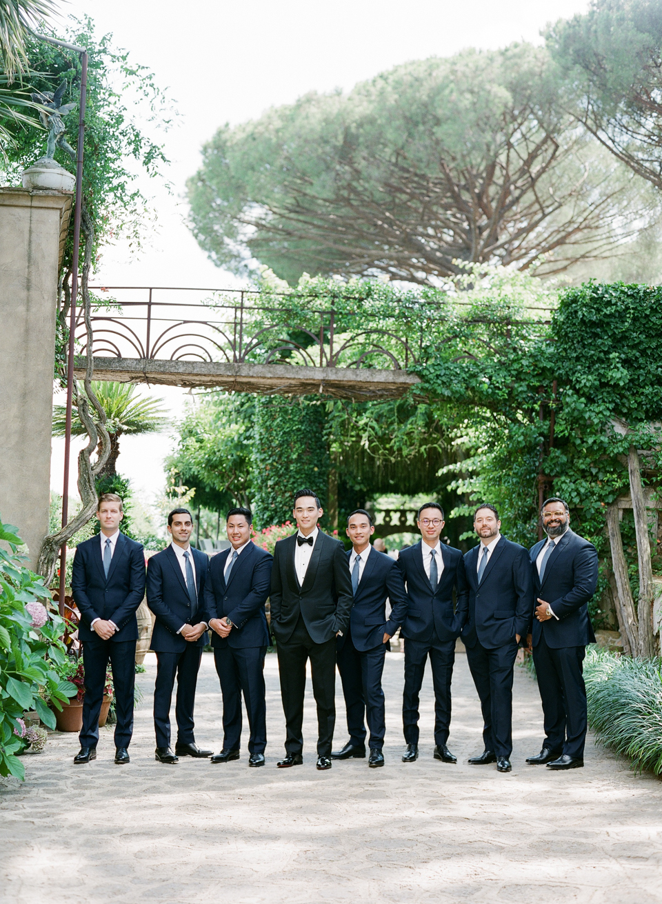 adrienne cameron wedding groomsmen in garden