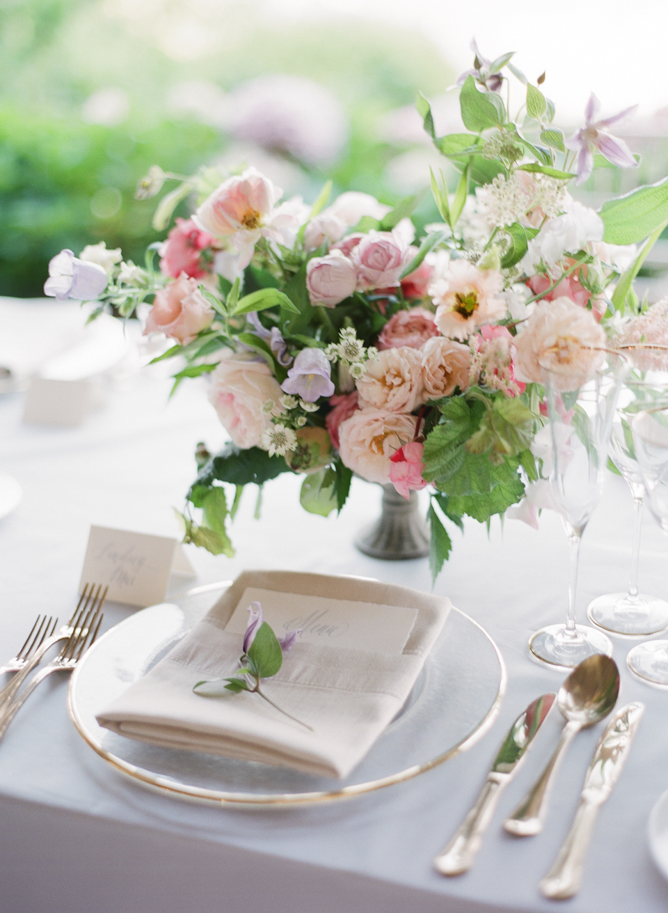 adrienne cameron wedding reception place setting with pink flowers
