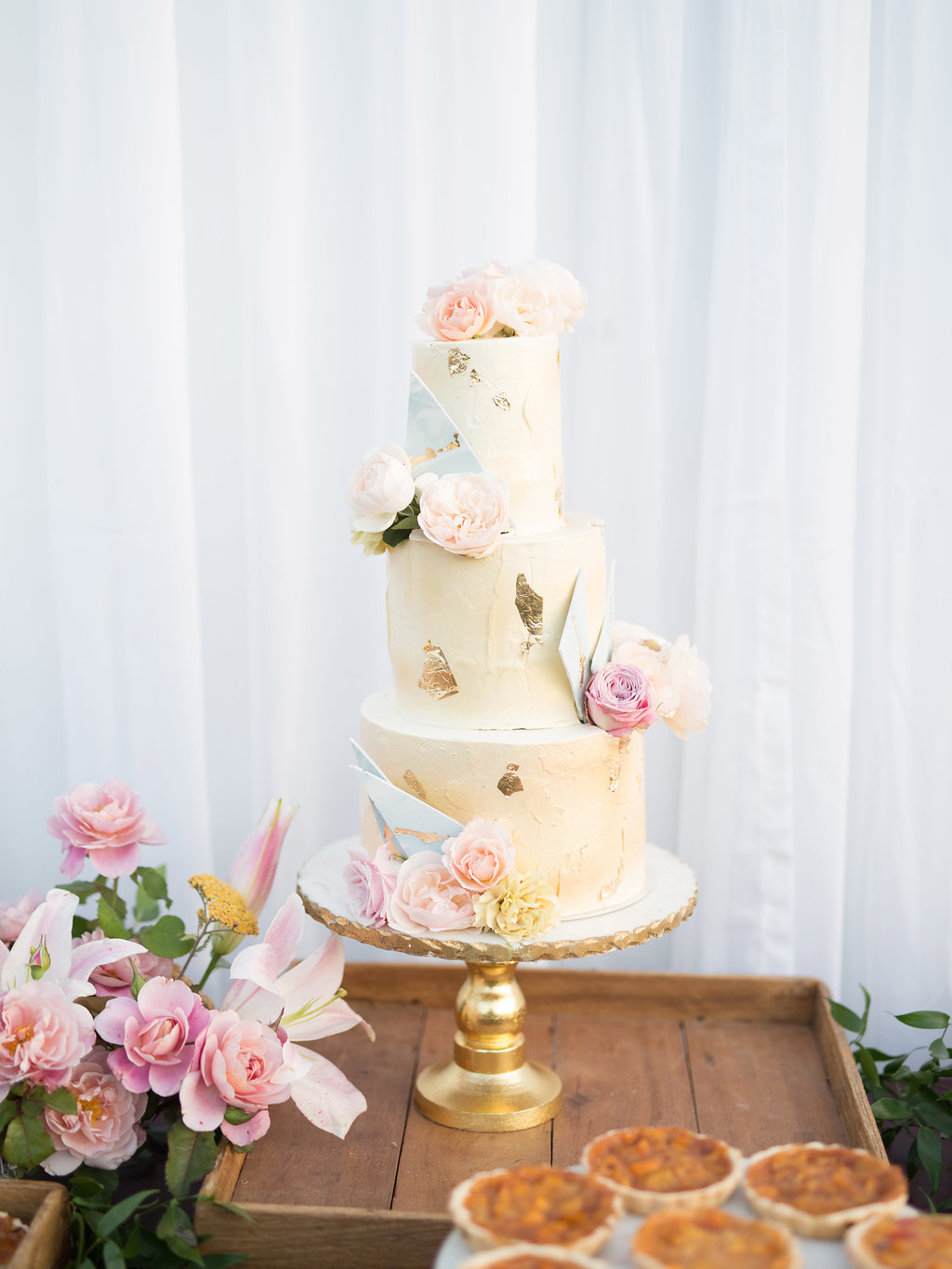 paige zack wedding cake on pedestal