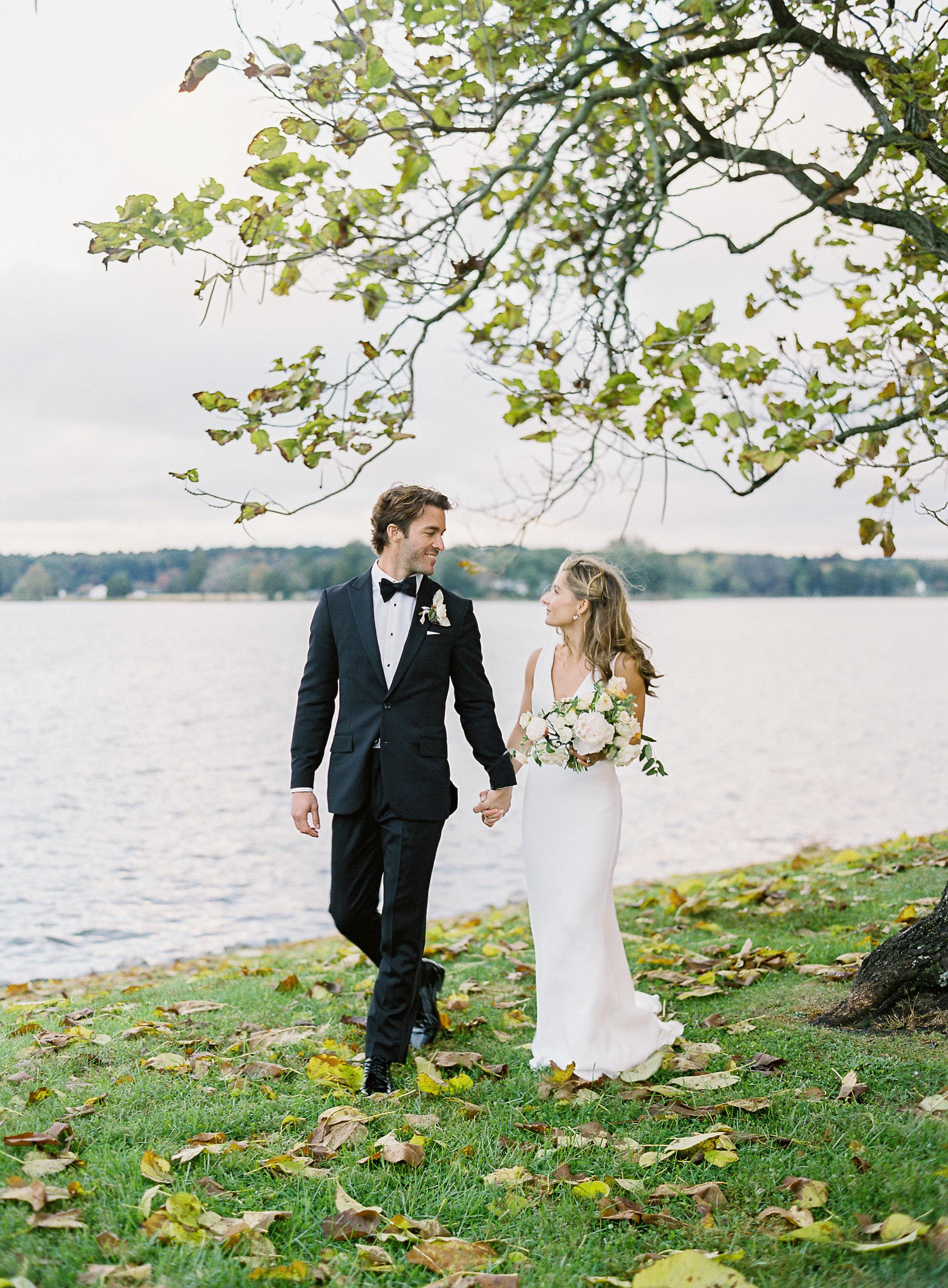 lauren alex wedding couple walking by water