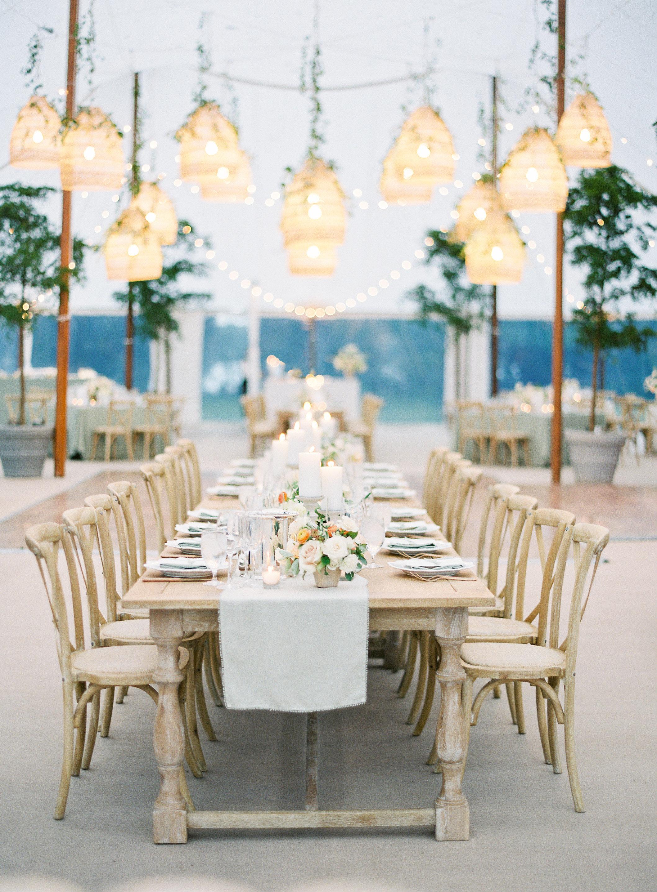 lauren alex wedding reception tables with lights hanging above