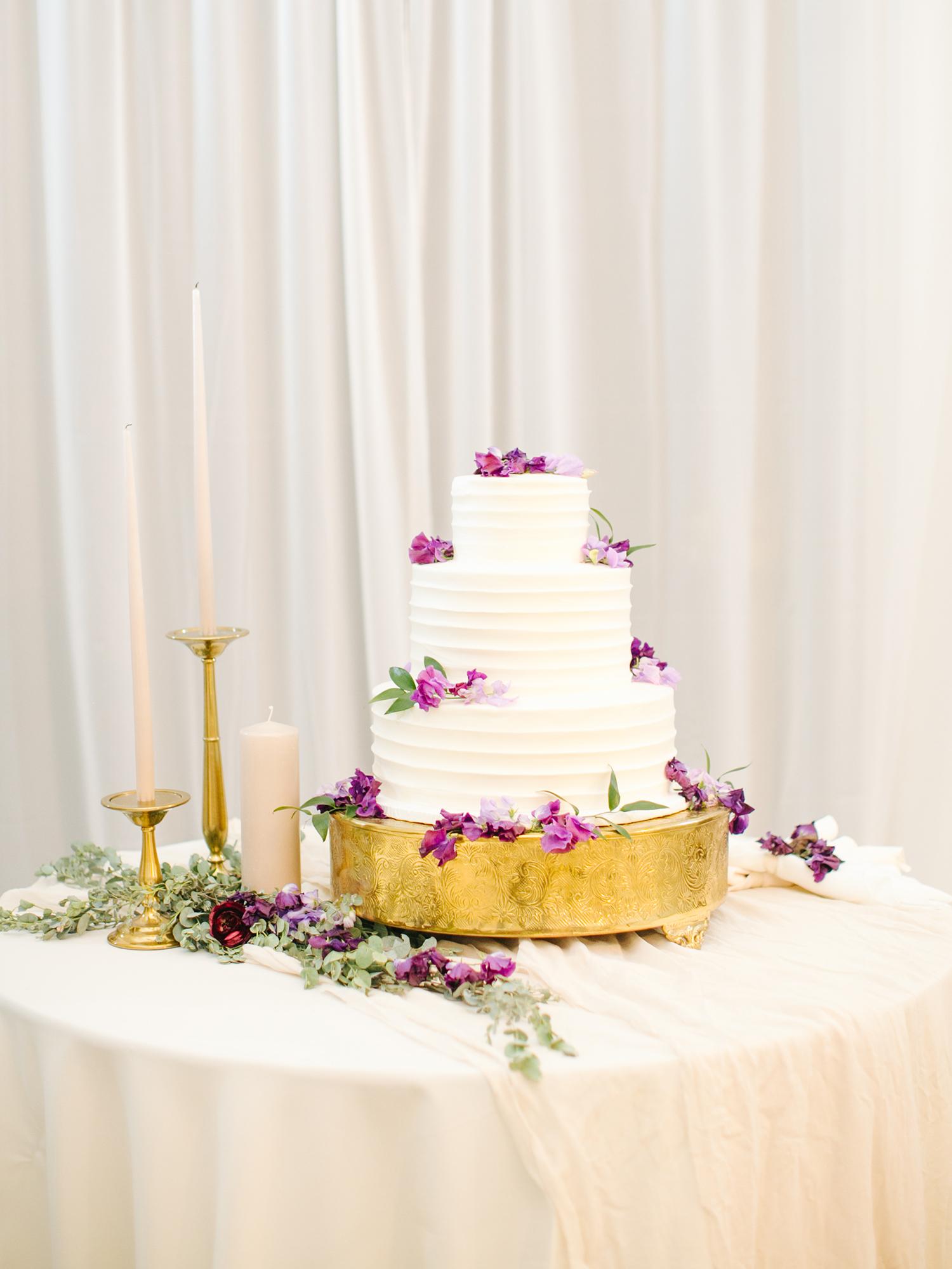 molly josh wedding cake on golden stand