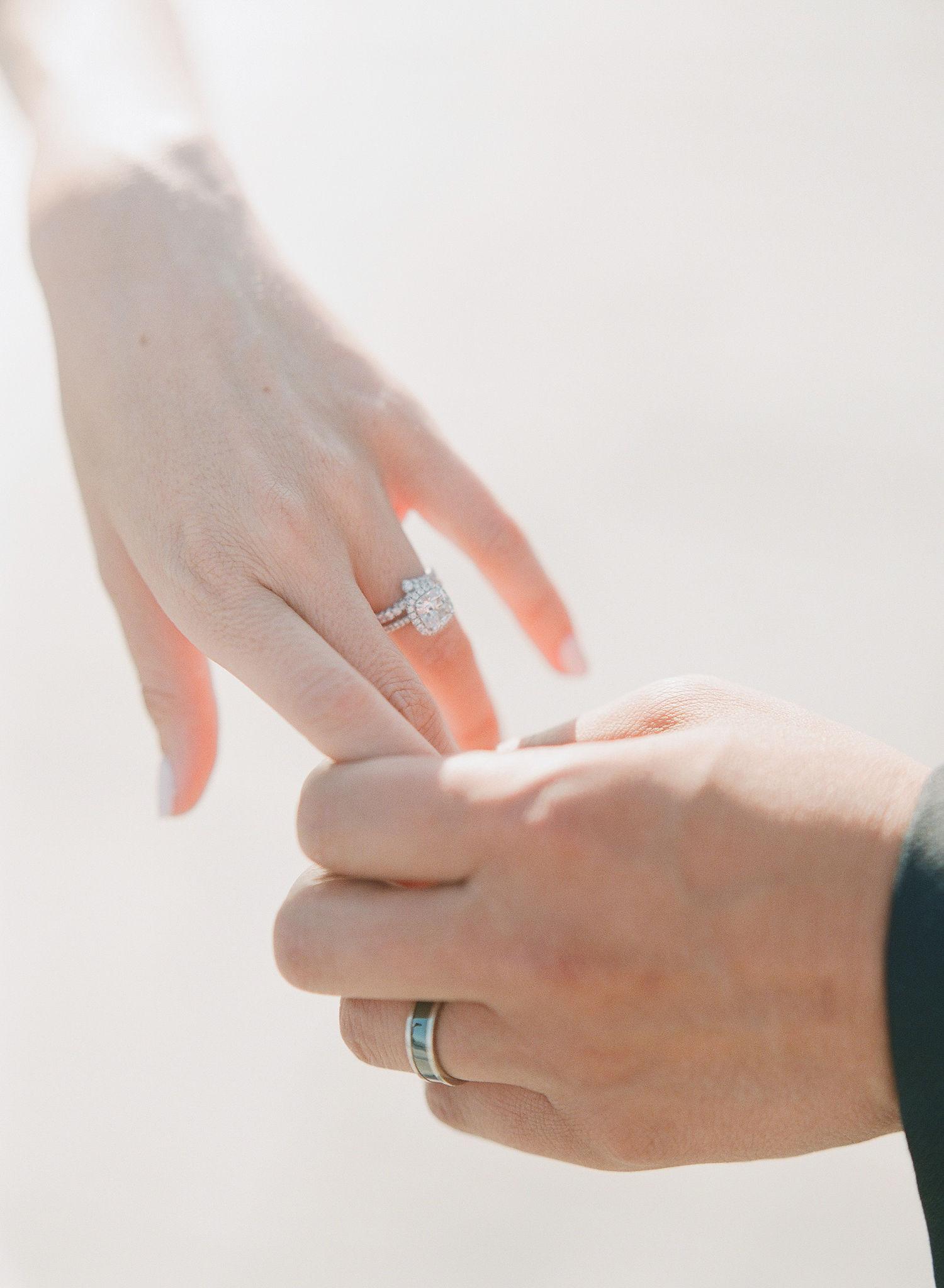 nicole and chris wedding couple hands
