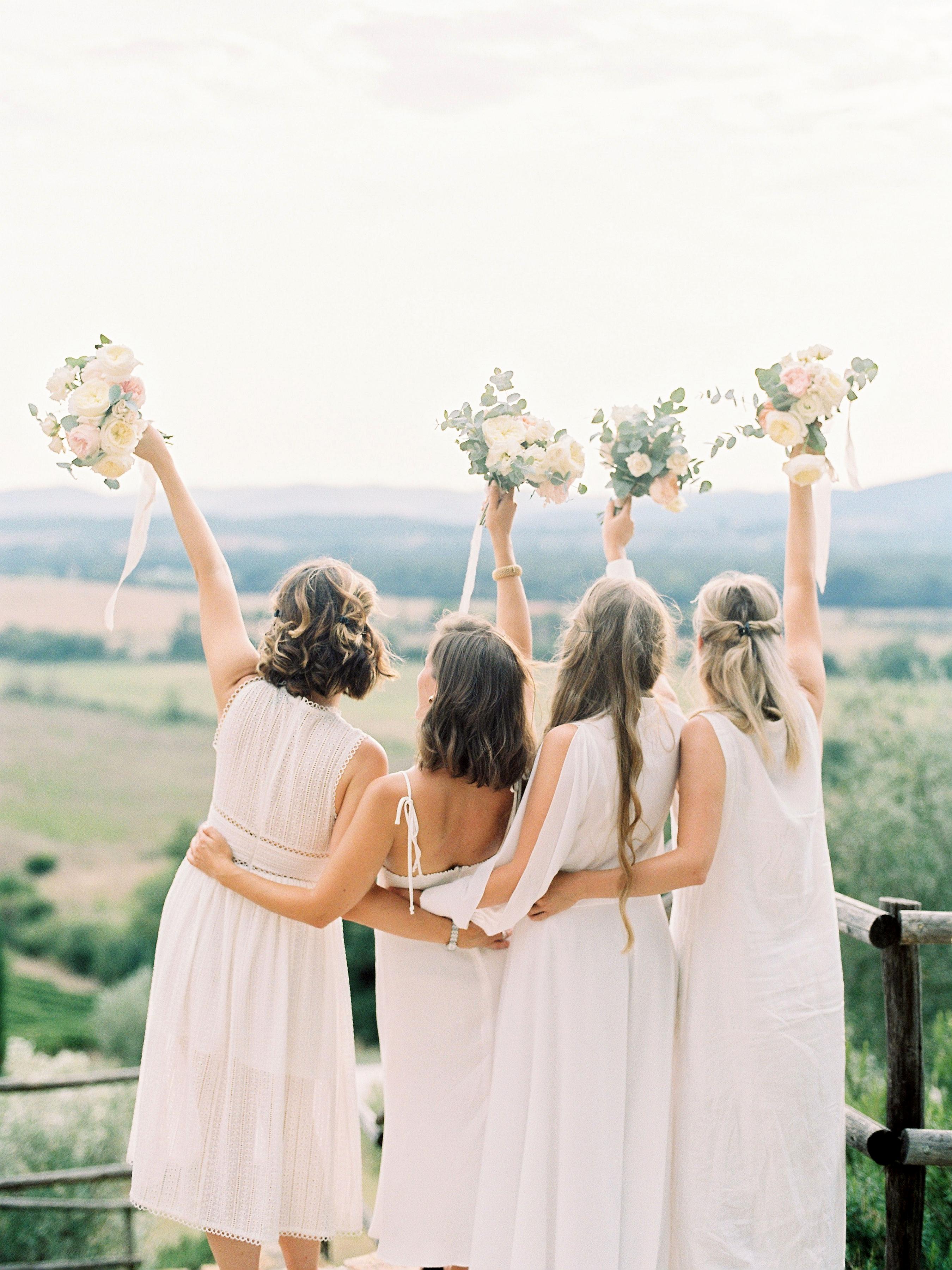 kseniya sadhir wedding italy bridesmaids waving bouquets